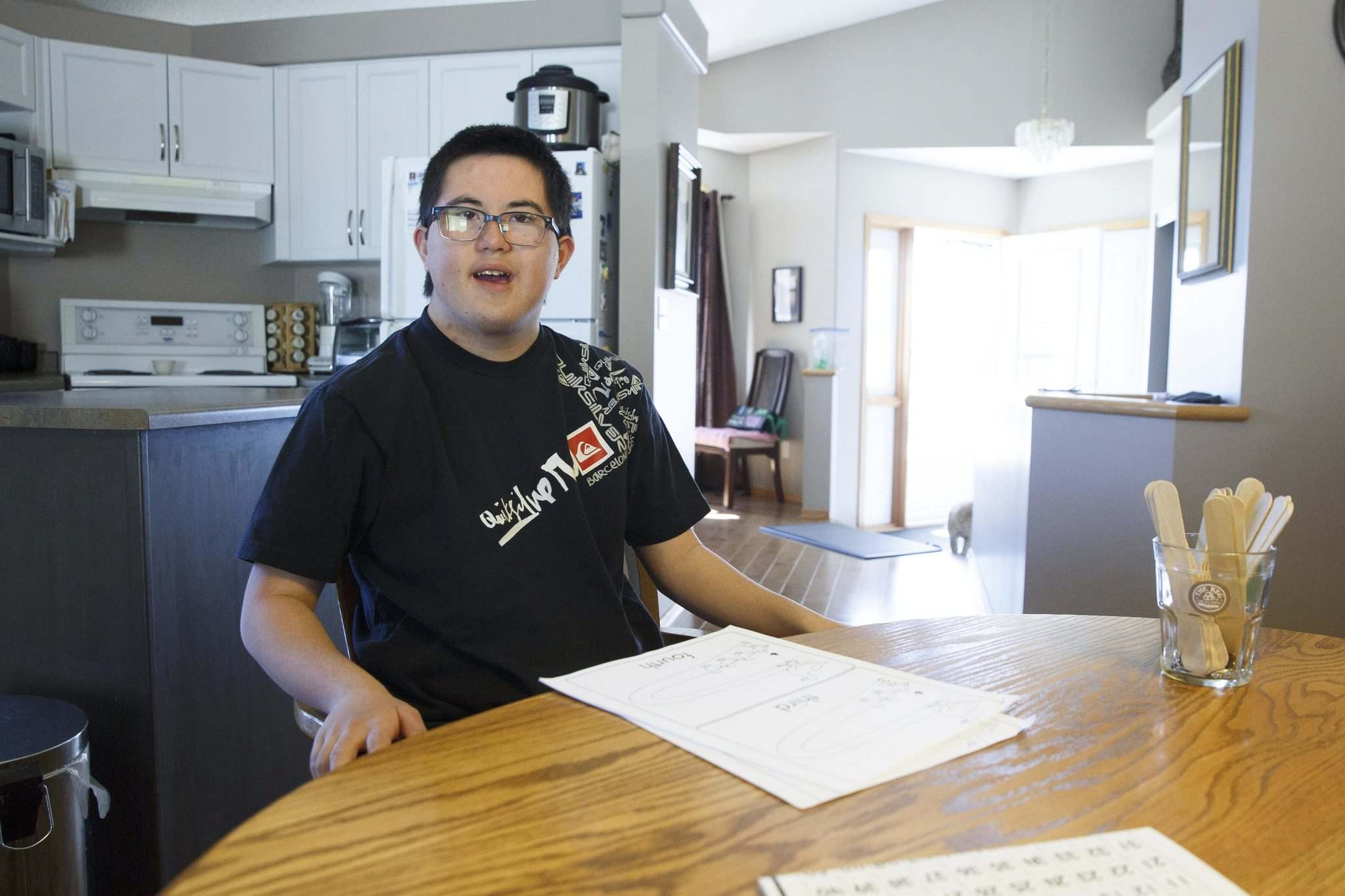 Daniel Cowen, 20, is about to lose 'the closest thing to a regular day' he has, and it's frustrating to his mother, Cathy. (Mike Deal / Winnipeg Free Press)
