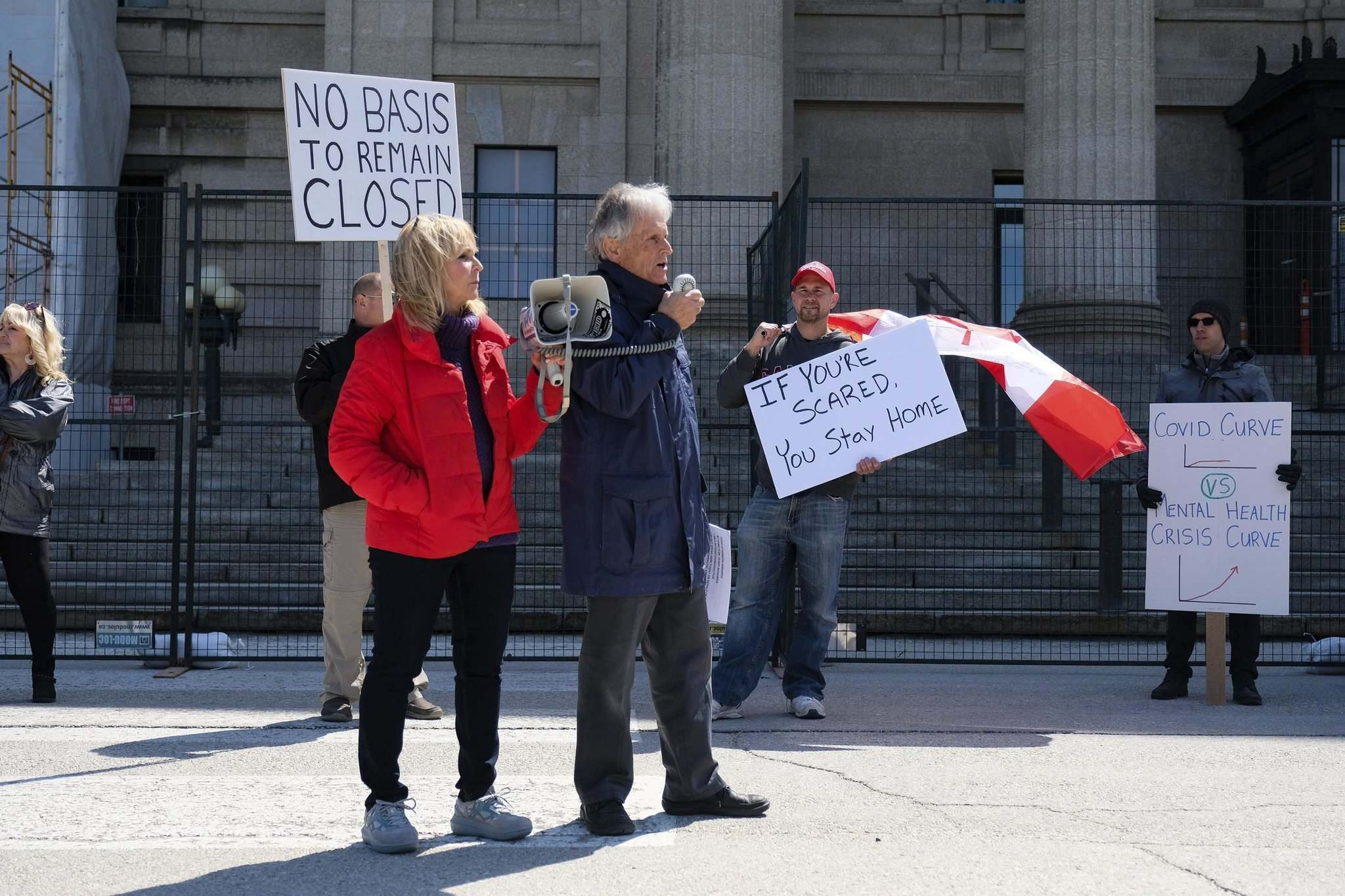 Event organizer Gerry Bohemier (centre), speaks to the protesters. (Daniel Crump / Winnipeg Free Press)</p>