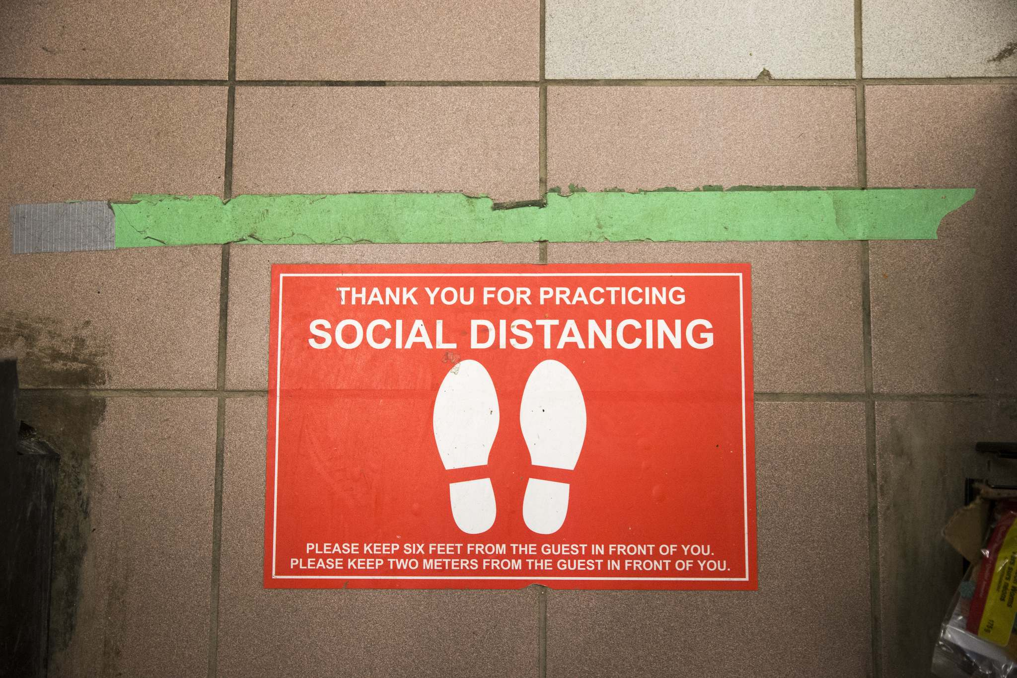 Gone are the days of chatting in grocery lines: social-distancing floor decals ensure shoppers remain two metres apart.</p></p>