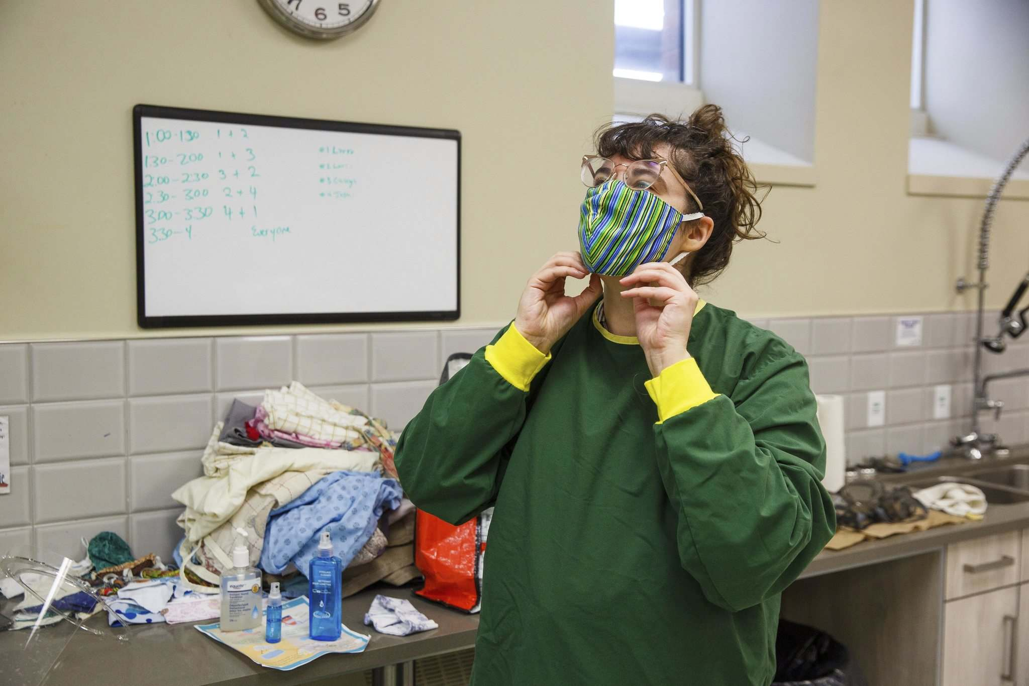 Morrison decks herself out in personal protective equipment before a recent shift. (Mike Deal / Winnipeg Free Press)</p>
