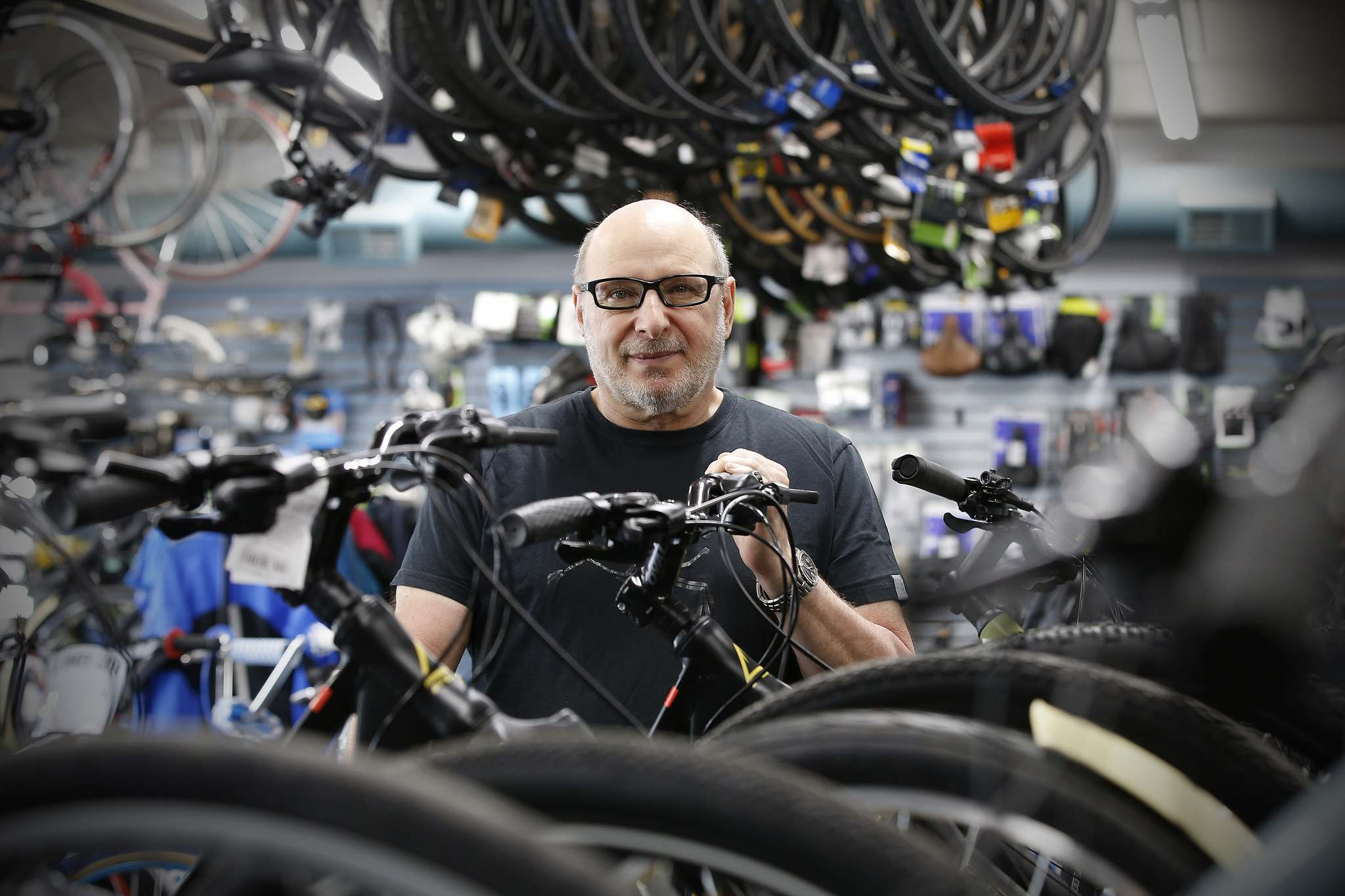 Brian Burke, owner of Olympia Cycle and Ski on St. Mary's Road, is seeing a boost in business during this COVID-19 pandemic.</p>