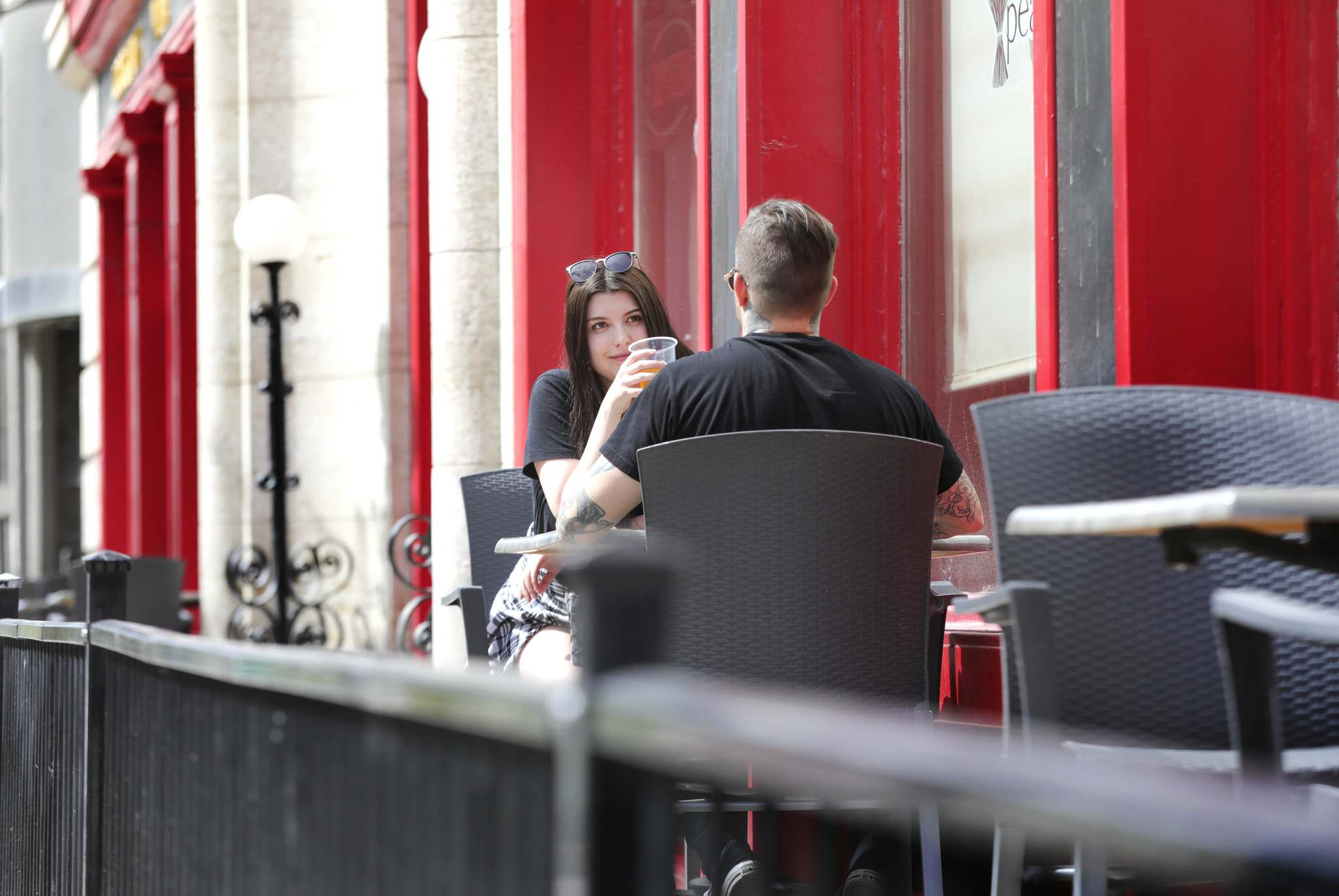 Diners enjoy a drink while on the patio at Peasant Cookery.</p>