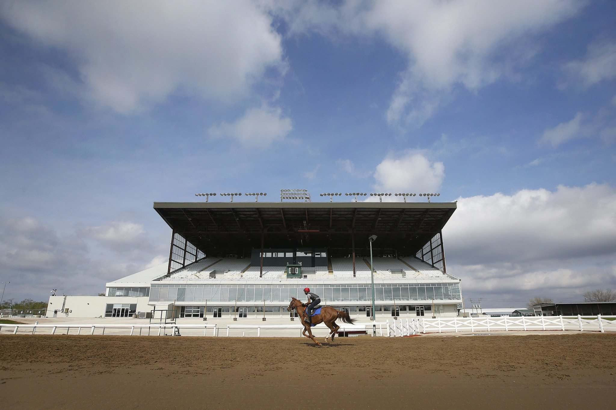 Jockey Richard Mangalee rides a race horse Sunday at Assiniboia Downs. Racing begins tonight but there will be no live spectators due to the COVID-19 pandemic. (John Woods / Winnipeg Free Press)</p>