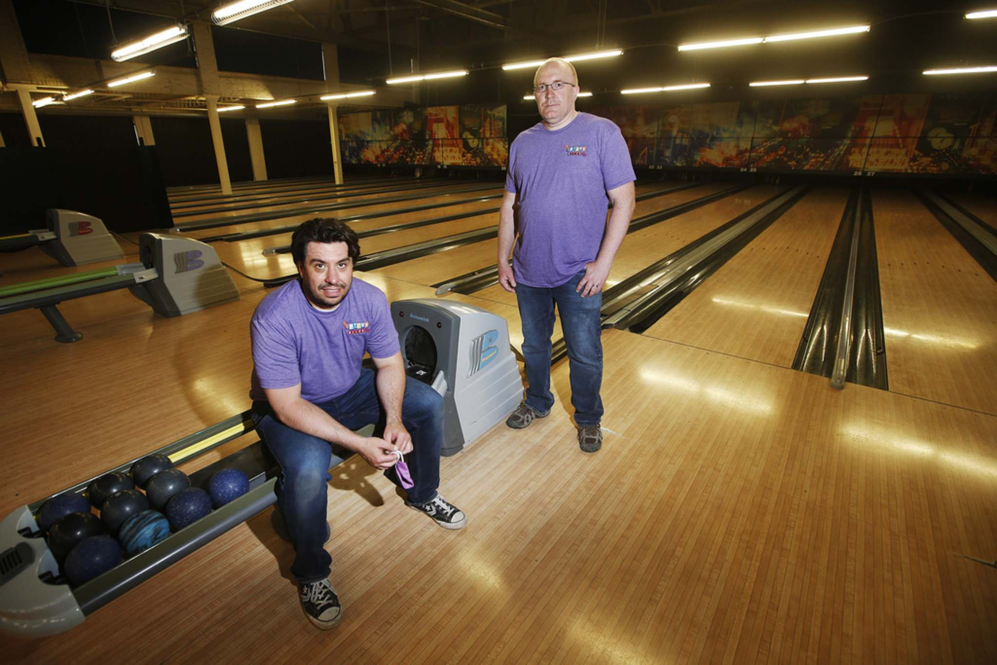 Uptown Alley's Nathan Hogg, manager (left) and Todd Britton, co-owner, are getting ready to reopen with strict new measures in place. (John Woods / Winnipeg Free Press)