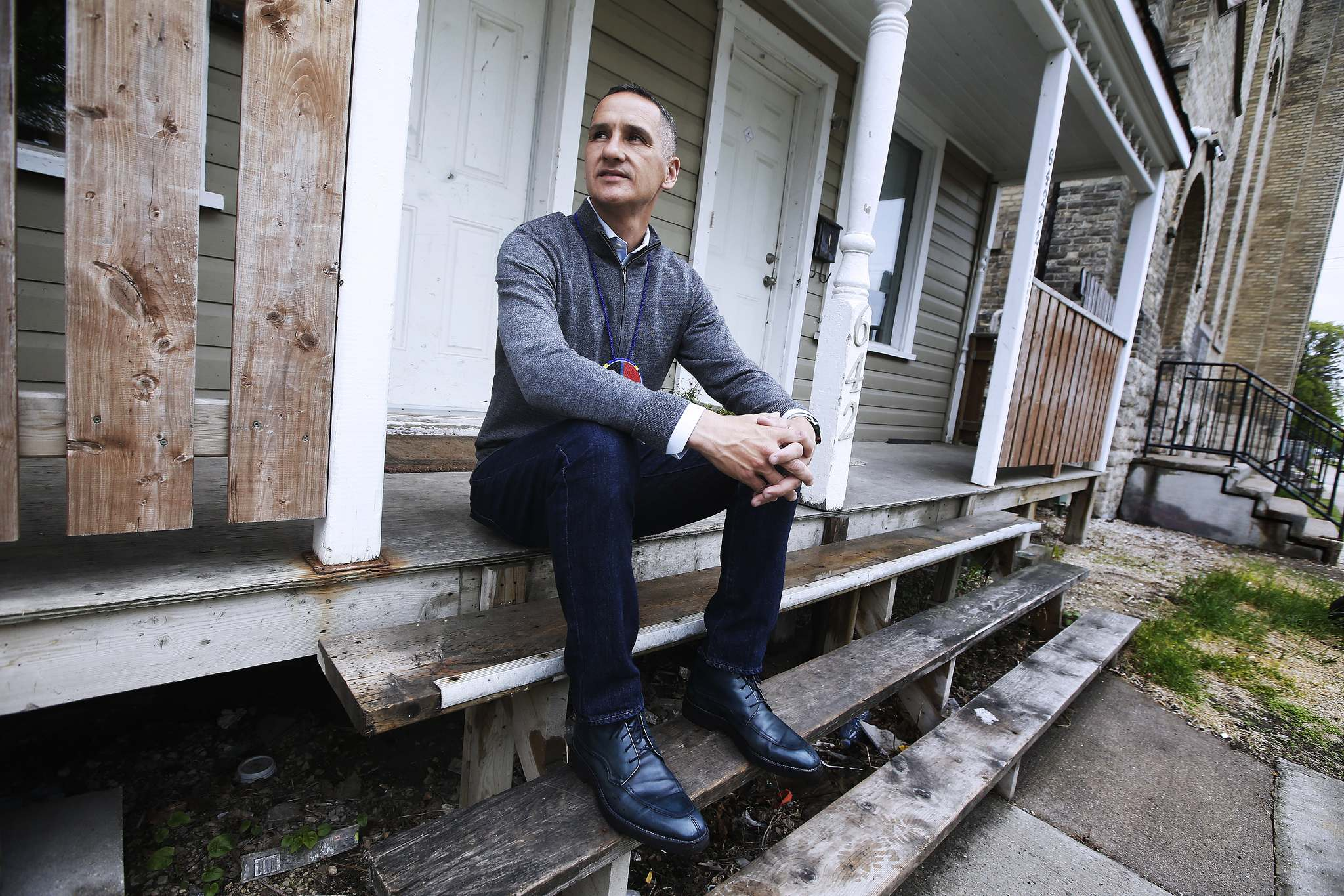 Chief sits on the steps of his childhood home on Burrows Avenue.</p>