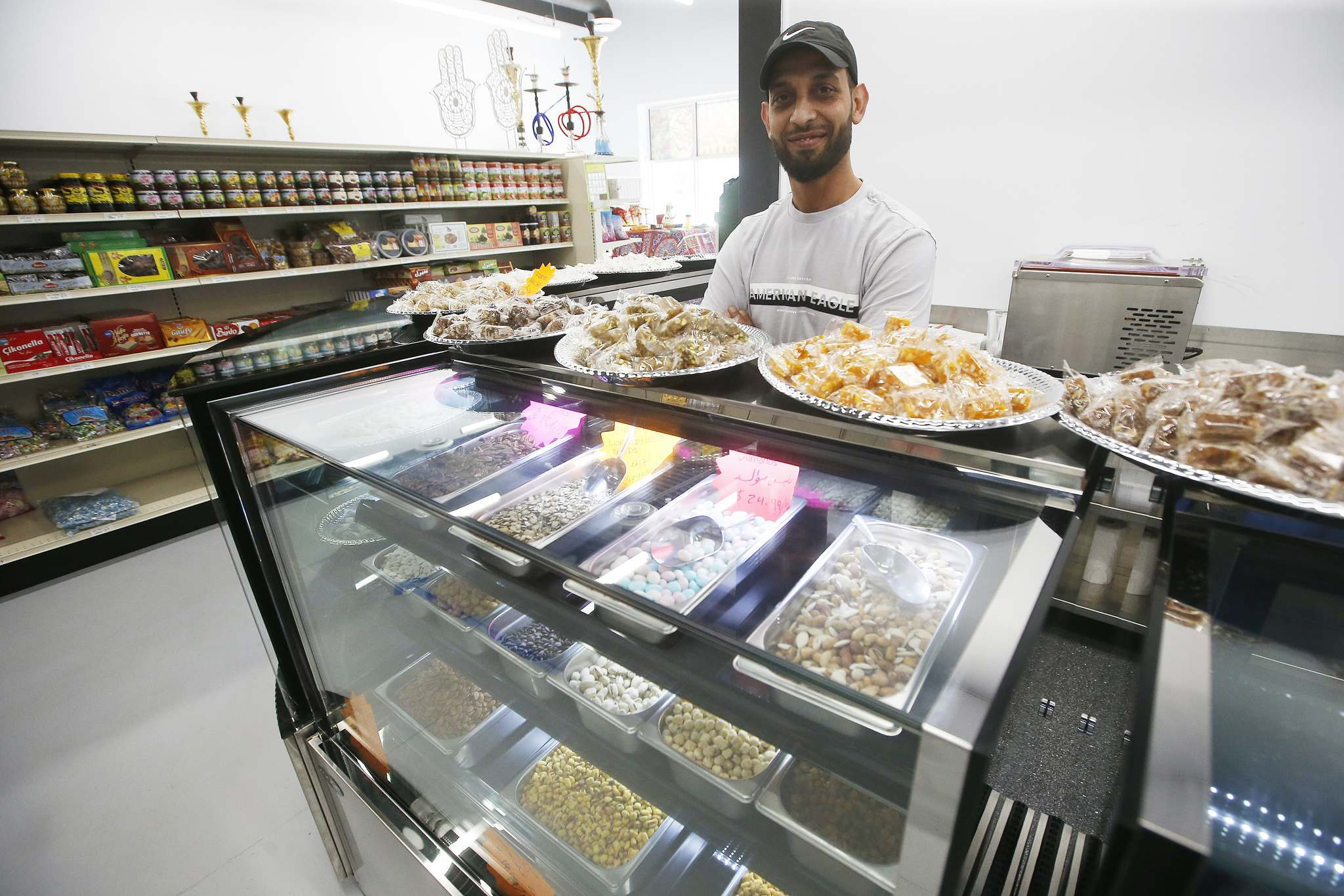 JOHN WOODS / WINNIPEG FREE PRESS</p><p>Mohammad Naser, owner of Tarboosh Middle Eastern, in his new grocery store that specializes in Middle Eastern food.</p>