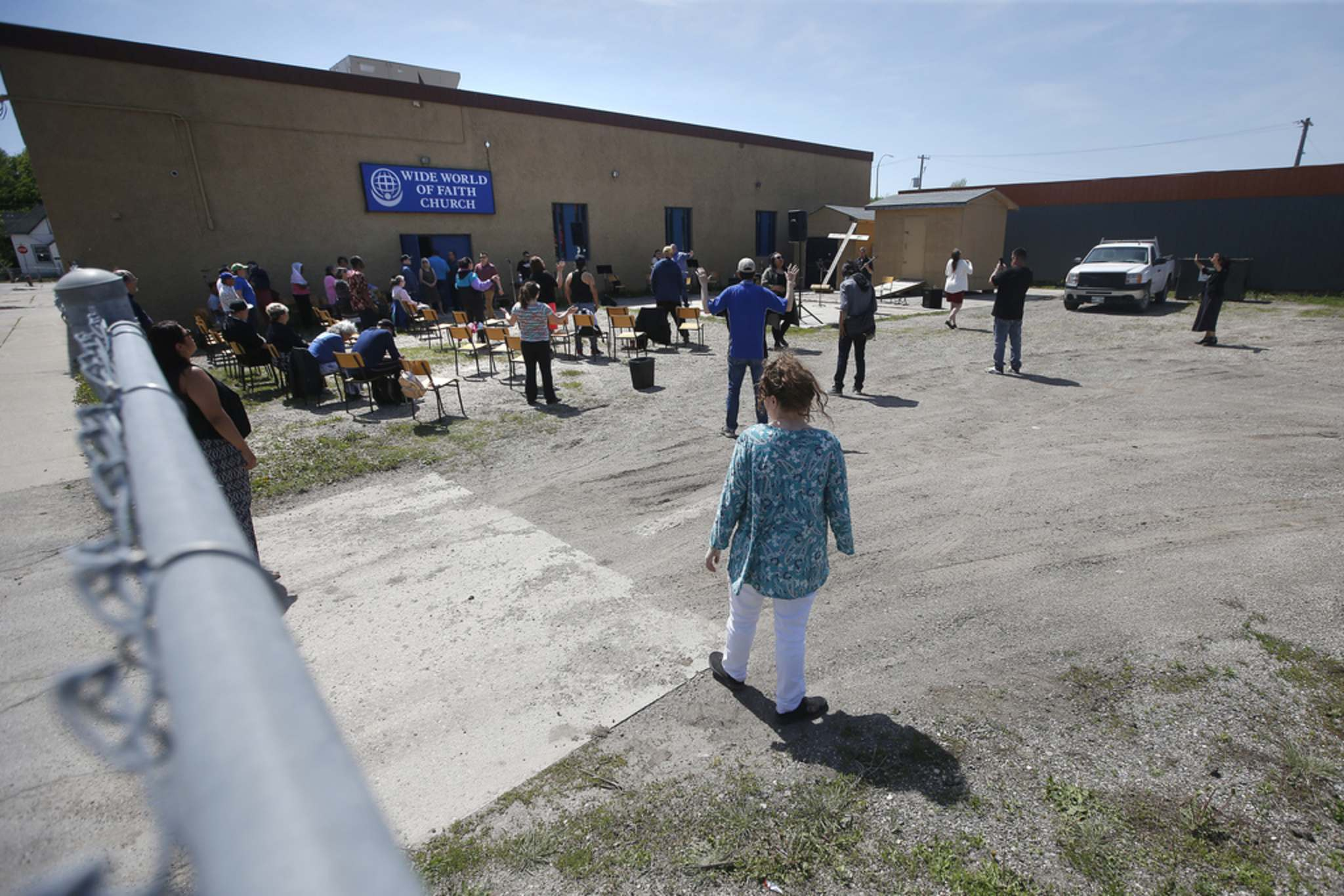 Church doesn't mean being inside. Teachings can also mean people meet regularly in houses or back yards, much like they did in the parking lot at the Wide World of Faith Church on May 31. (John Woods / Winnipeg Free Press files)</p>