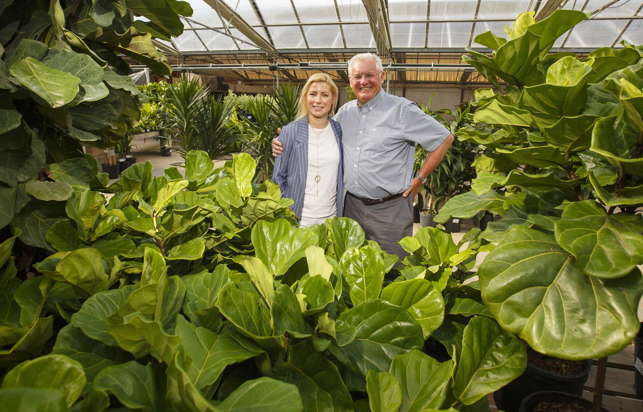 Nicole Bent, owner of Shelmerdine Garden Centre Ltd, and her father, Bo Wohlers, owner of Shelmerdine Ltd.: 'He told me to go work with trees and shrubs.' (Mike Deal / Winnipeg Free Press)</p>