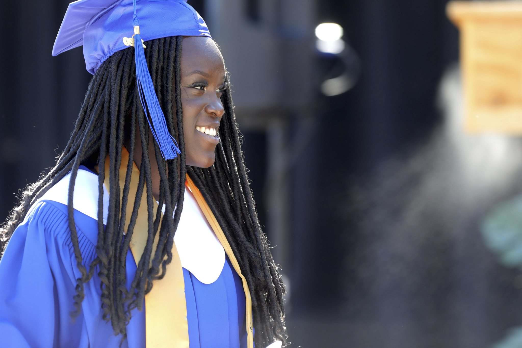 Valedictorian Nyume Mahmoud makes her way to the stage to give her speech to her fellow students on Wednesday.