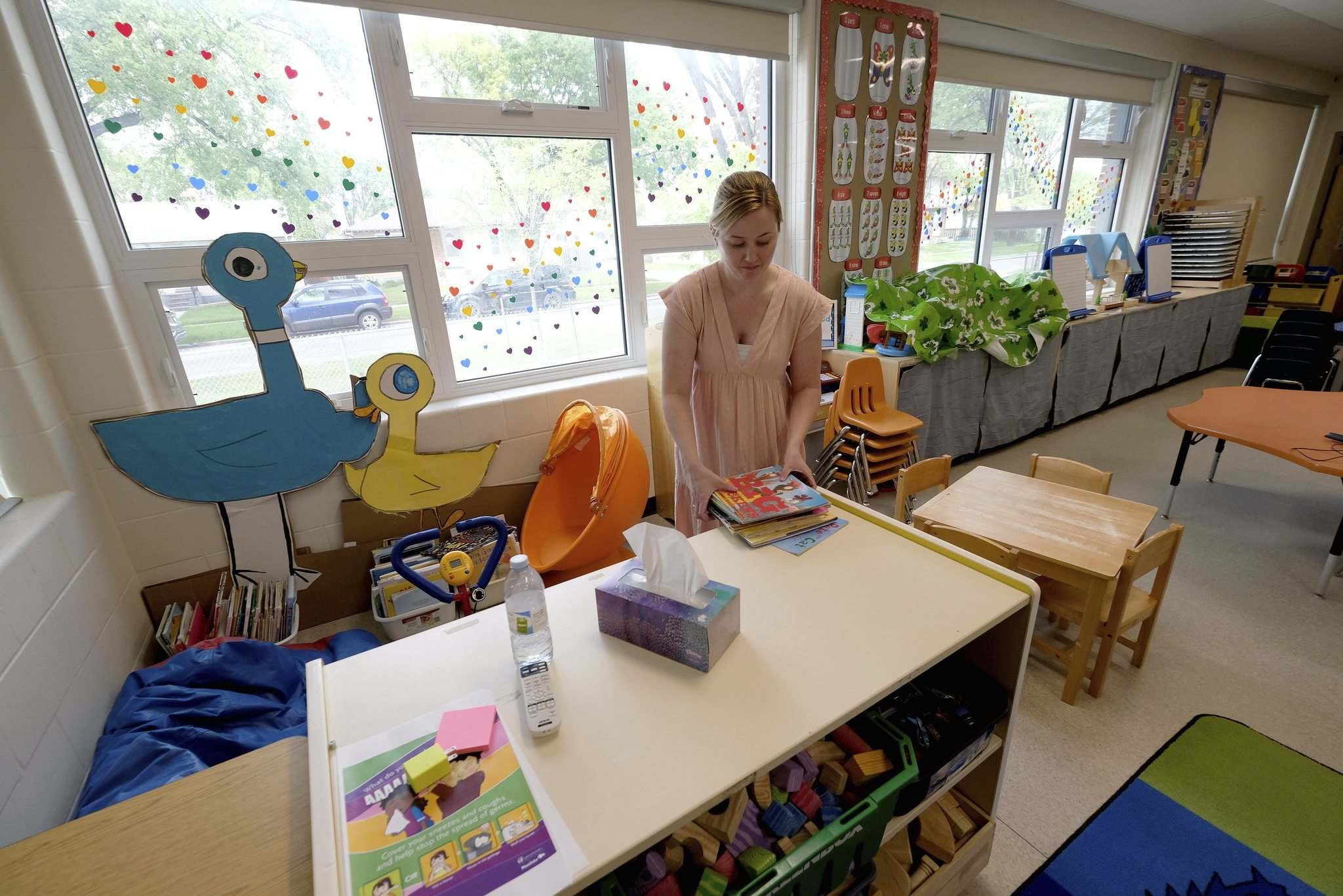Kindergarten teacher, Kristy Frohwerk, prepares her classroom at Lord Nelson School for the eventual return of students. (Shannon VanRaes / Winnipeg Free Press)