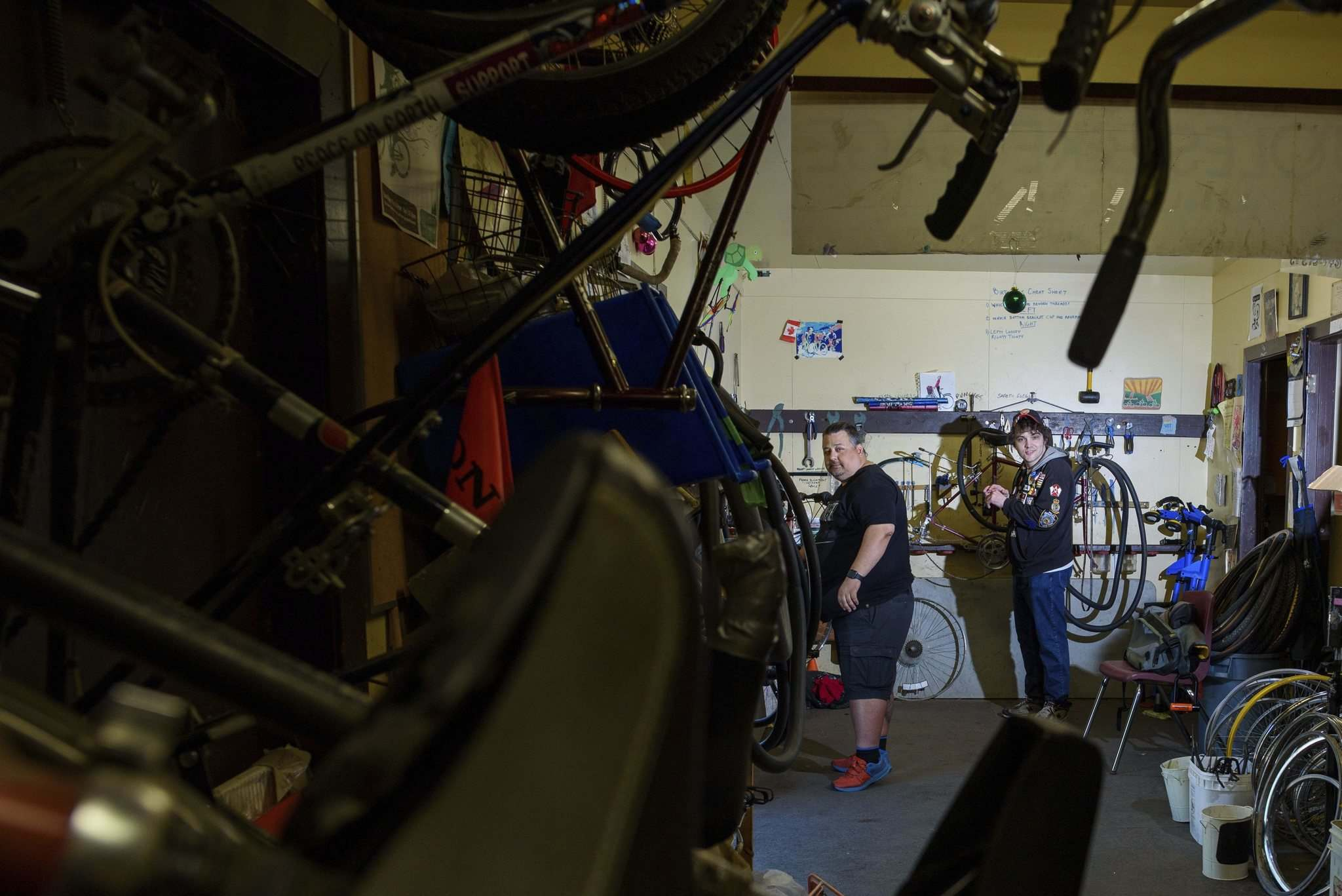 Maciejko and Charles Pearce (right), another volunteer, keep busy in the shop packed with bikes for repair. (Jesse Boily / Winnipeg Free Press)</p></p>