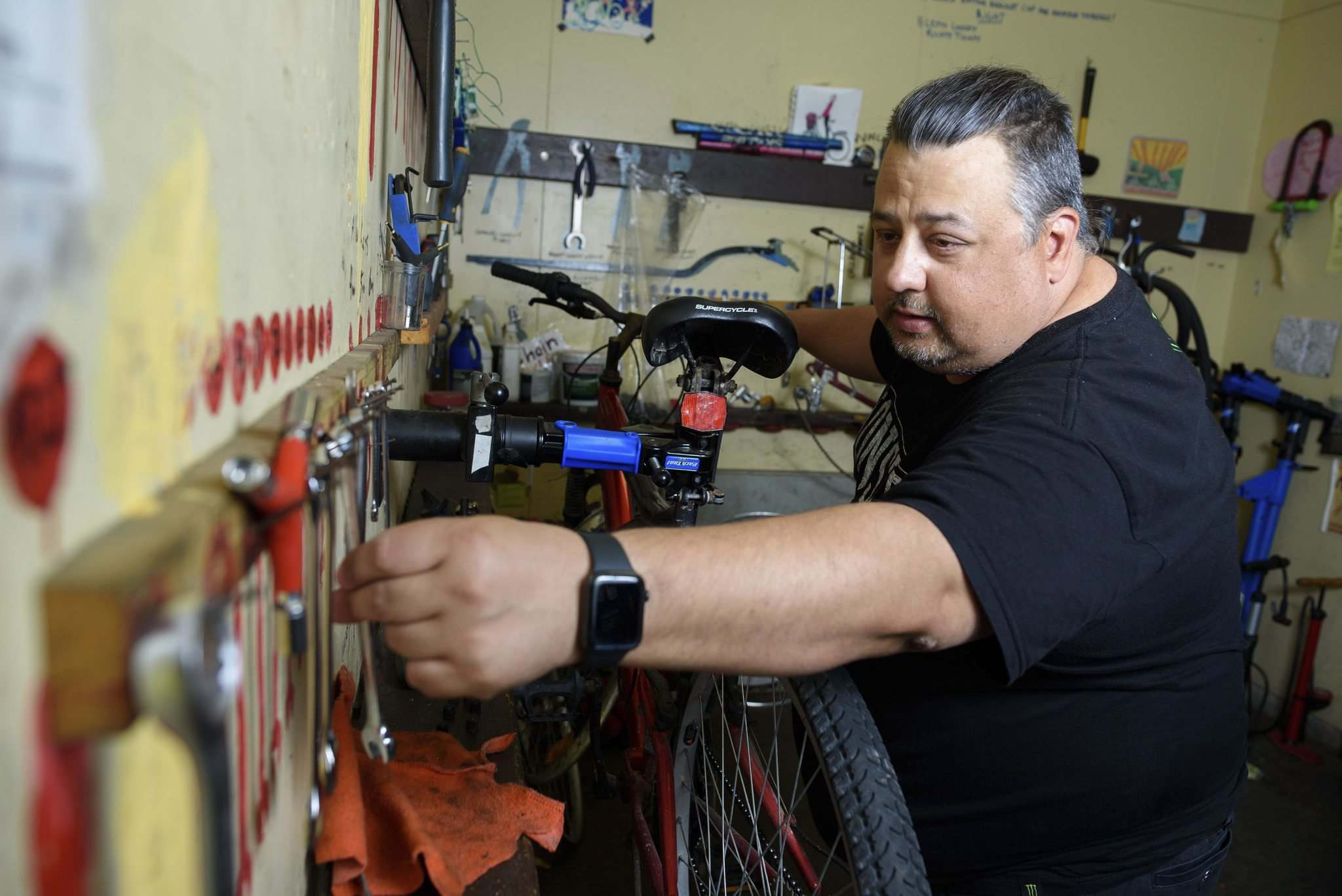 Aaron Maciejko, a volunteer at Orioles Bike Cage, a community bicycle shop that helps people repair and maintain their bicycles, works on a bike. (Jesse Boily / Winnipeg Free Press)</p>
