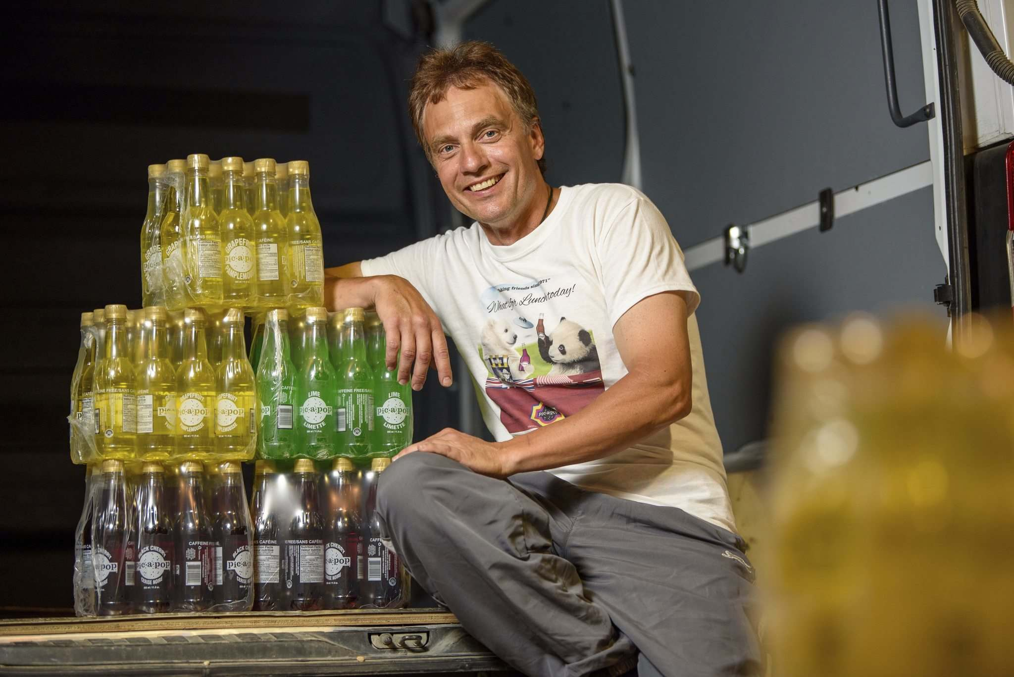 Michael Nykorak, the plant manager at Canadian Gold Beverages, with a stack of Pic-a-Pop. Canadian Gold uses the original formulas to produce classic Pic-a-Pop flavours. (Jesse Boily / Winnipeg Free Press)</p>