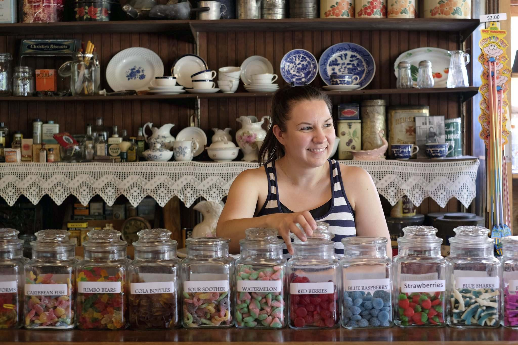 Amber Hiebert sells a variety of wares and treats in the Mennonite Heritage Village's General Store. (Shannon VanRaes / Winnipeg Free Press)