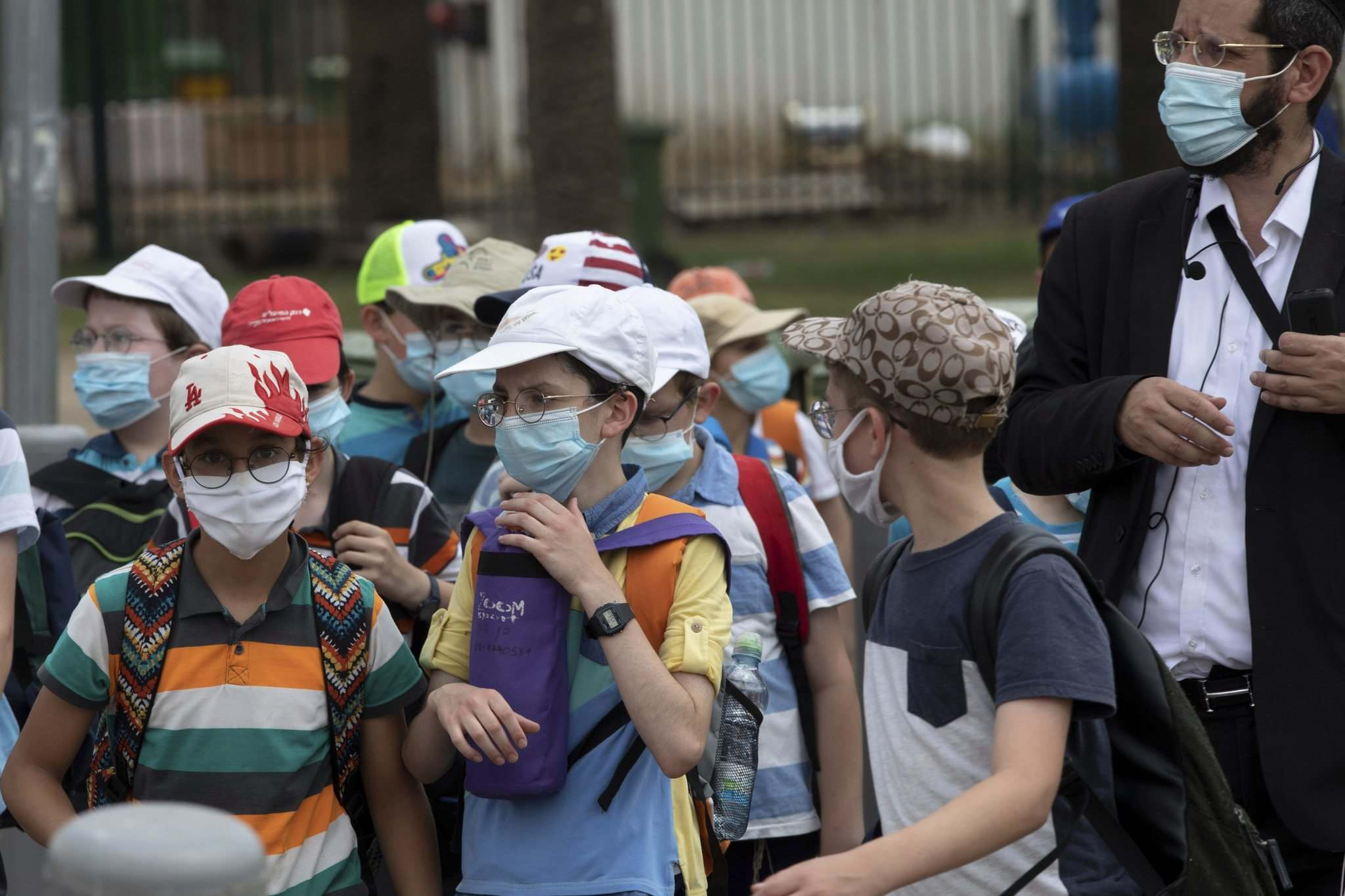 Israeli schoolchildren wear masks in Tel Aviv last month. After Israel opened businesses and schools, COVID-19 cases began to pop up. Hundreds of schools were forced to close again. (Sebastian Scheiner / The Associated Press files)