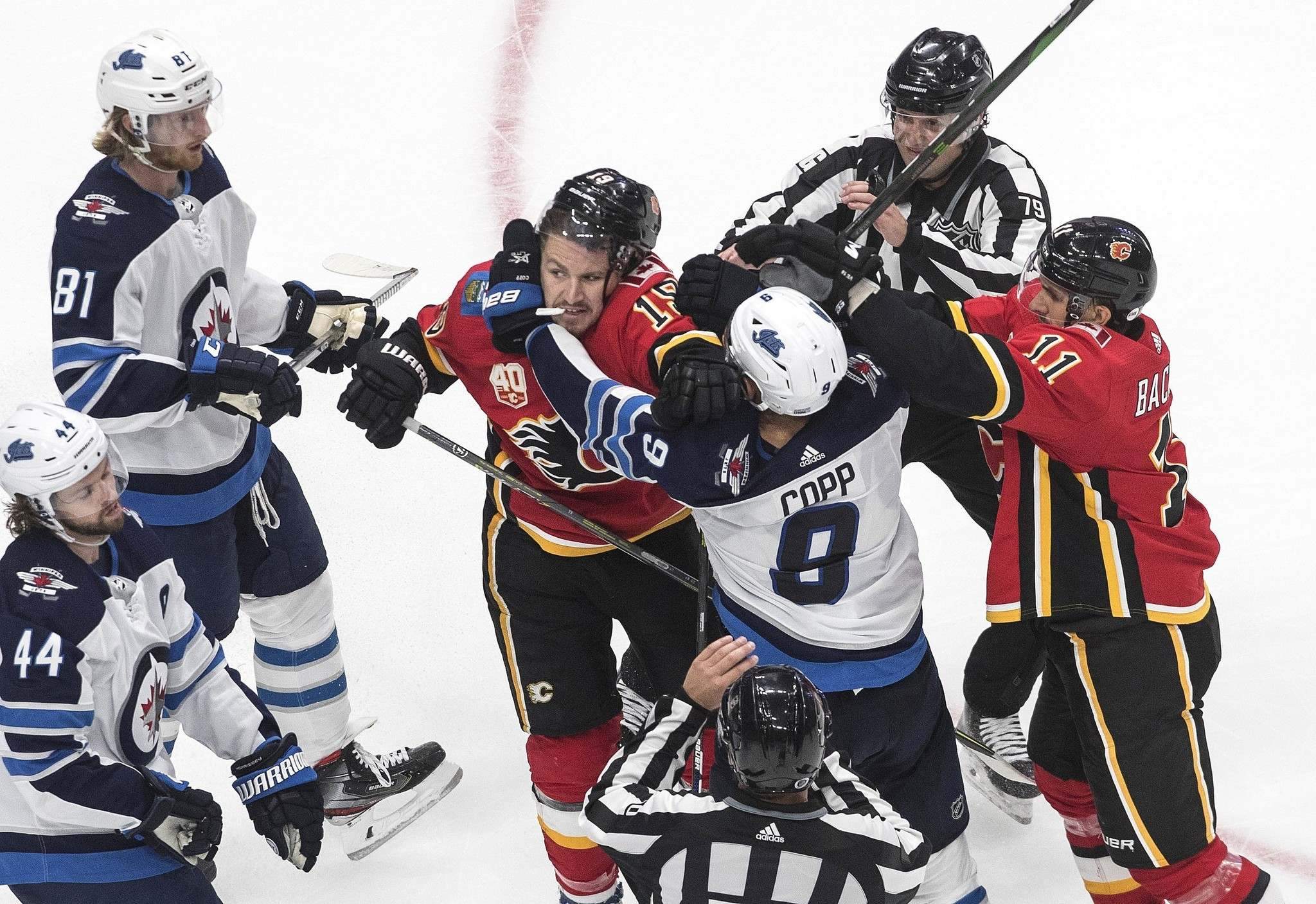 Jason Franson / The Canadian Press</p><p>Winnipeg Jets' Andrew Copp (9) and Calgary Flames' Matthew Tkachuk (19) rough it up during third period NHL qualifying round game action in Edmonton, on Monday August 3, 2020.</p>