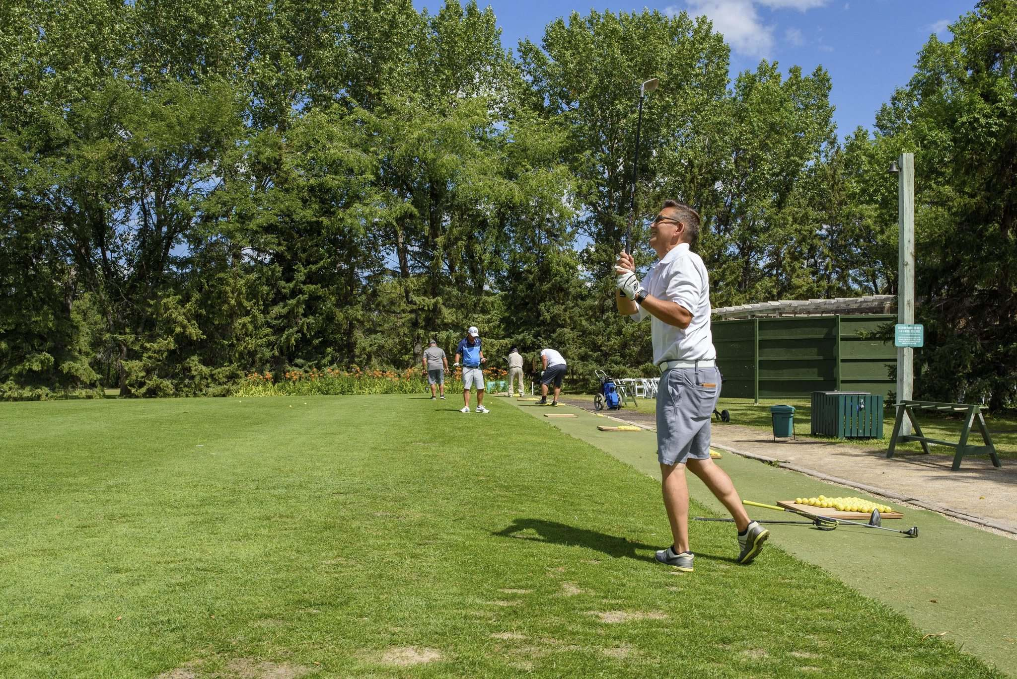 Wayne Shimizu hits some balls at the driving range at Rossmere Golf and Country Club Tuesday.