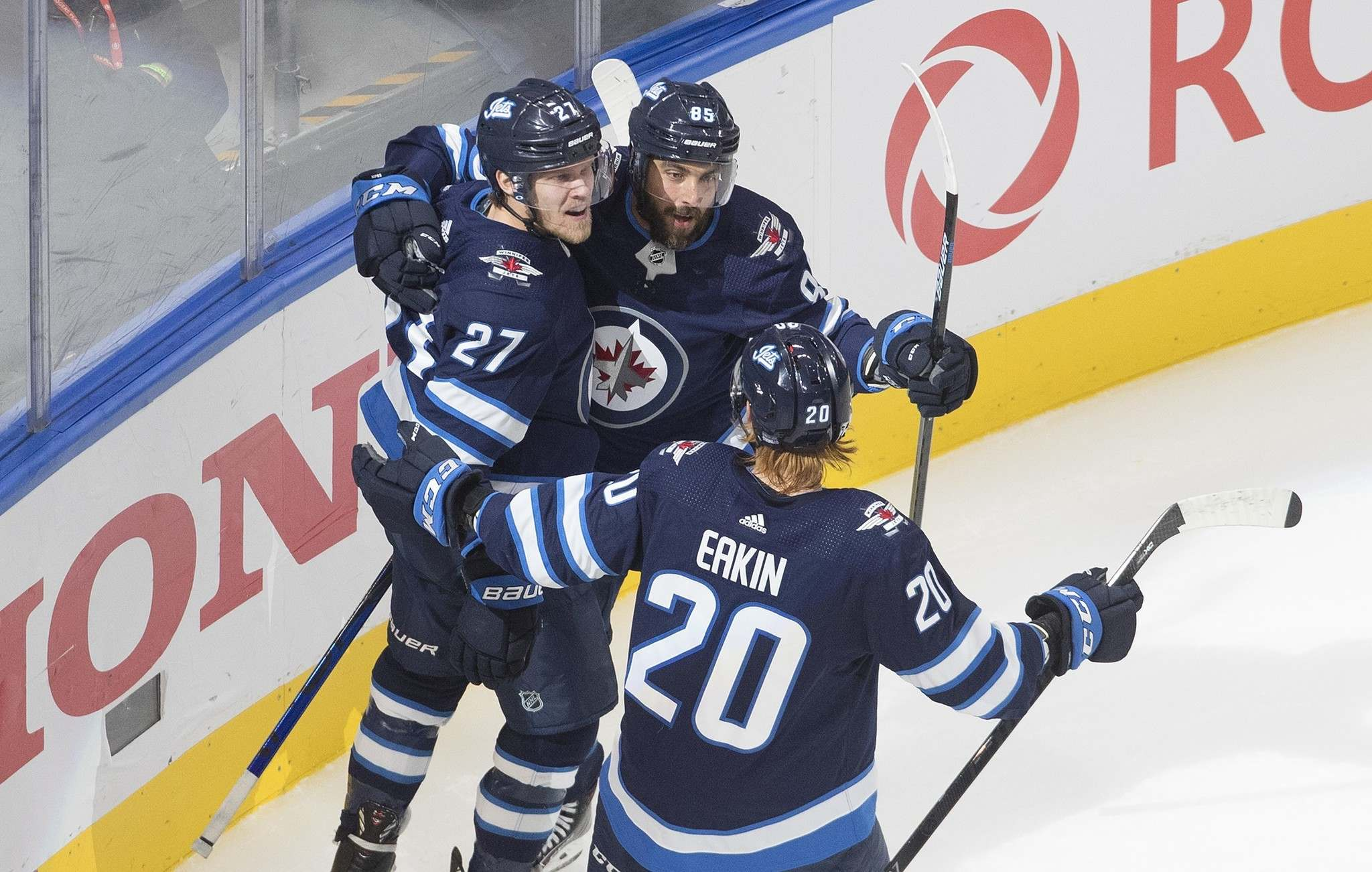 Jets forwards Nikolaj Ehlers, Mathieu Perreault and Cody Eakin, from left, celebrate a goal against the Flames during Tuesday's Game 4 loss. (Jason Franson / The Canadian Press files)</p></p>