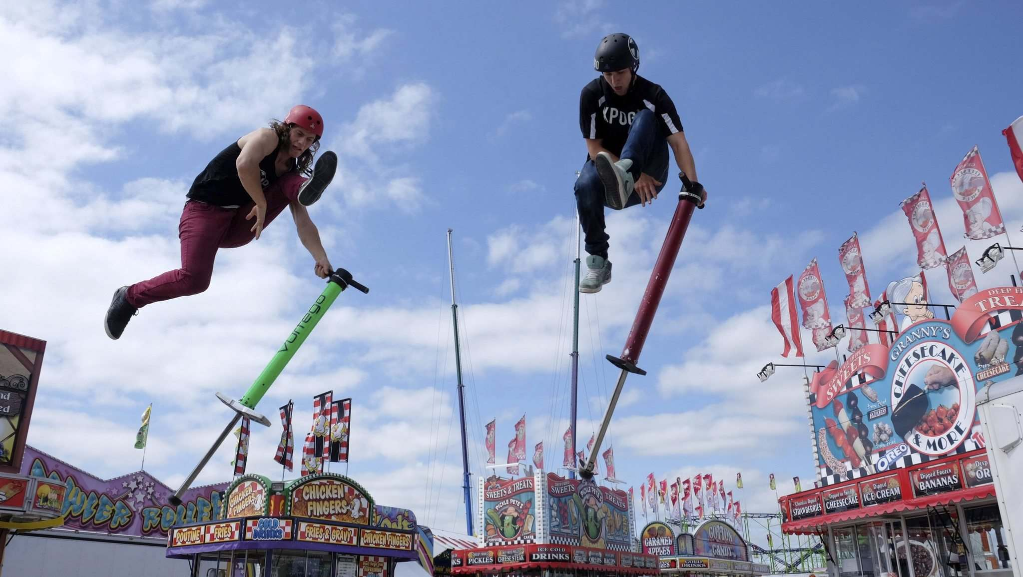 ZACHARY PRONG / WINNIPEG FREE PRESS</p><p>Xpogo athletes Daniel Mahoney (left) and Harry White practise their high-flying moves at the Red River Ex Thursday. The fair kicks off today.</p></p>