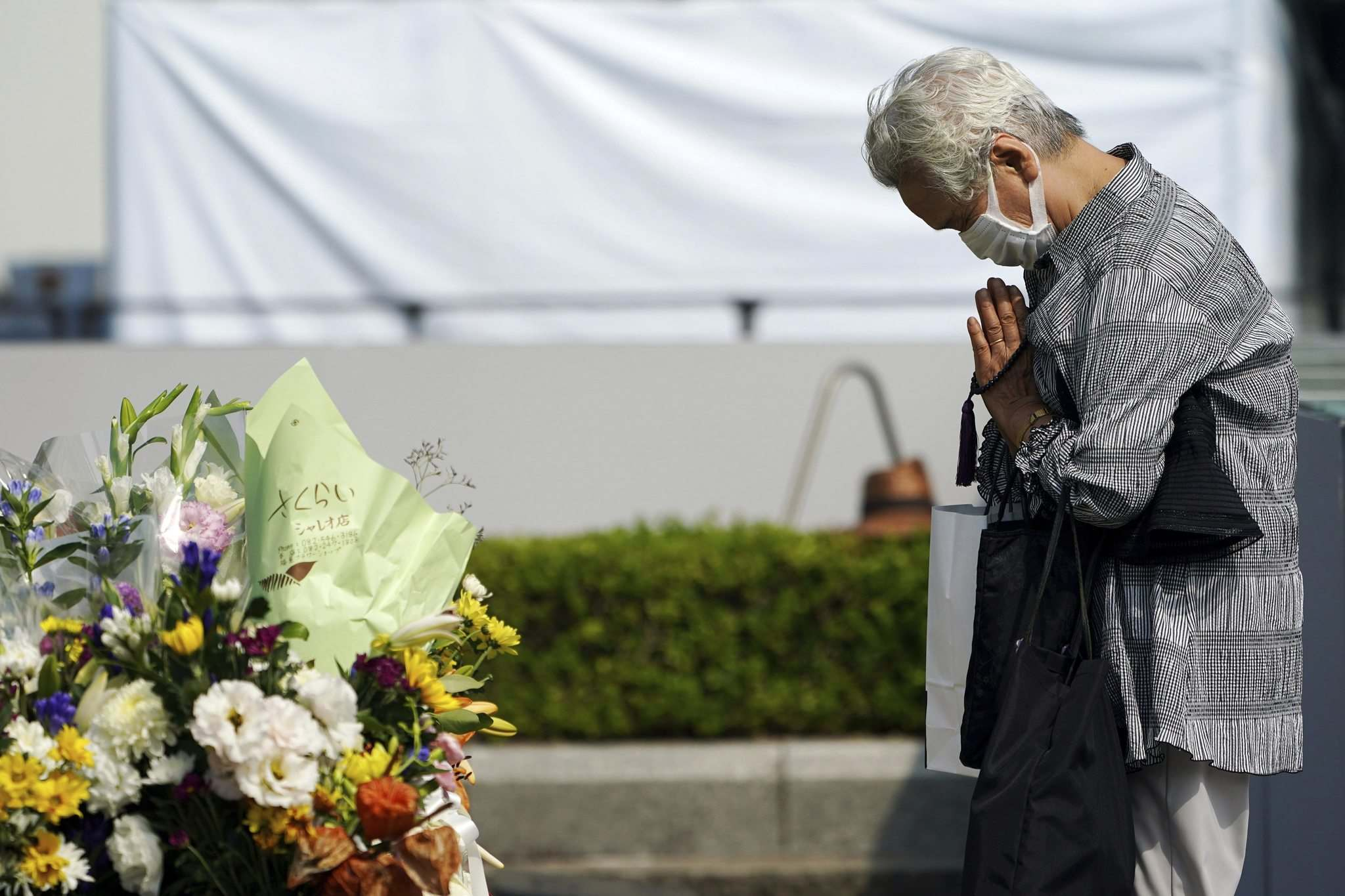 Eugene Hoshiko / The Associated Press</p><p>A visitor prays at the cenotaph near the Hiroshima Peace Memorial Museum in Japan on Wednesday. Today marks the 75th anniversary of the atomic bombing of Hiroshima.</p>