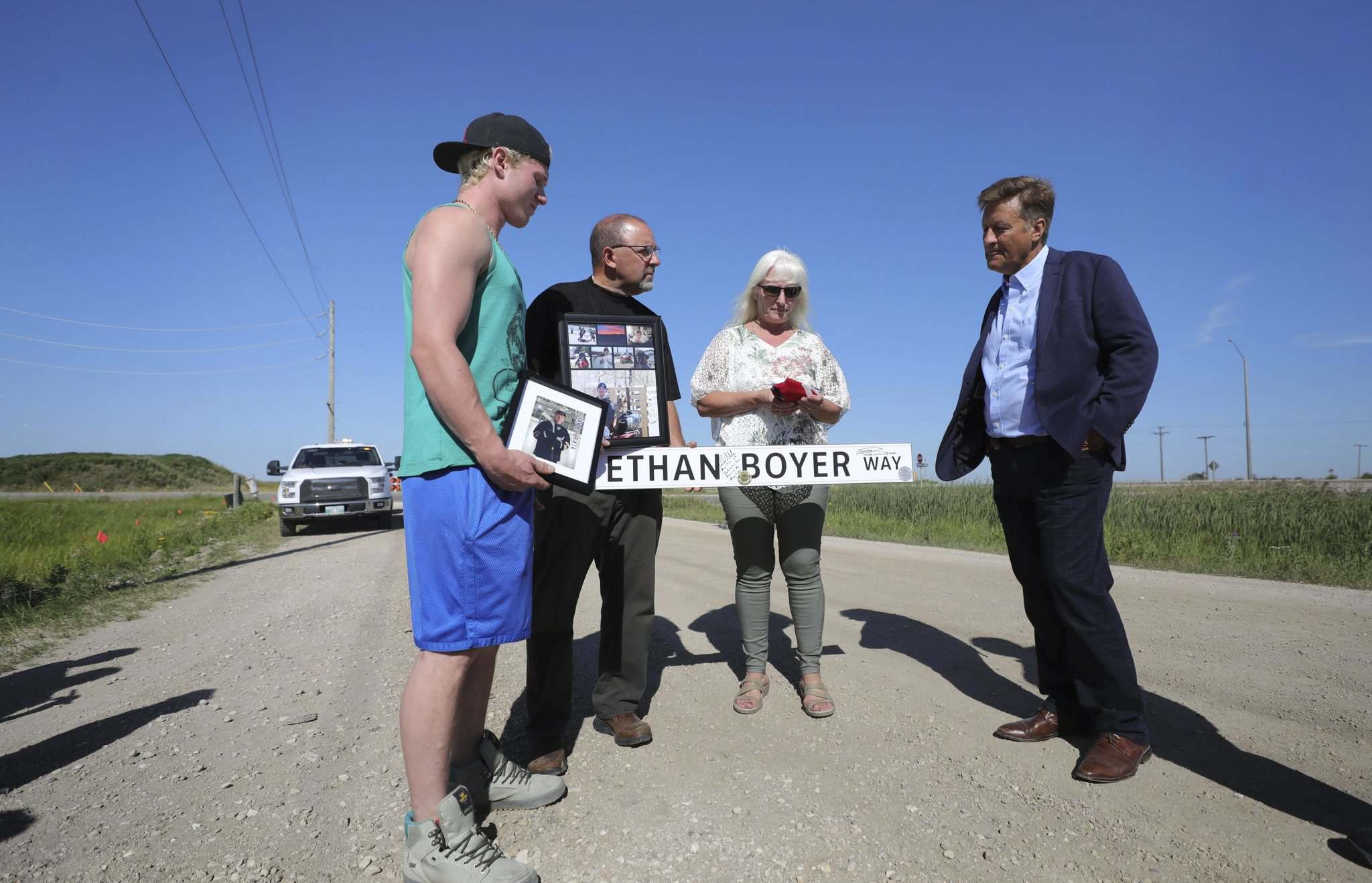 Ethan Boyer's brother Reid Boyer (from left), father Dana Boyer, mother Sue Zuk-Boyer and Infrastructure Minister Ron Schuler at the dedication of Ethan Boyer Way. (Ruth Bonneville / Winnipeg Free Press)</p>