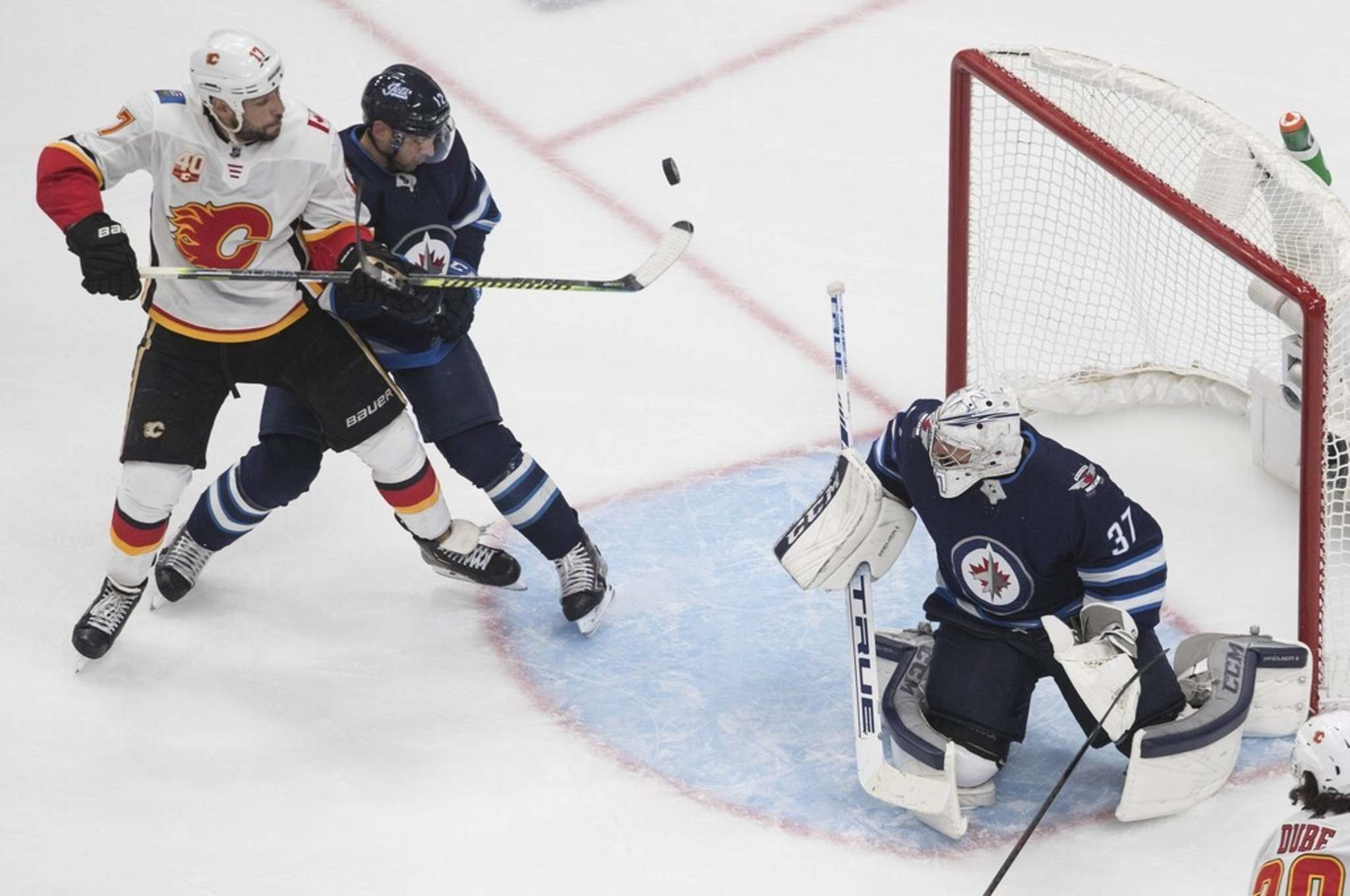 Connor Hellebuyck cut down his rebound rate by about eight per cent, but the Flames owned too much territory in front of him in the series.(Jason Franson / The Canadian Press)