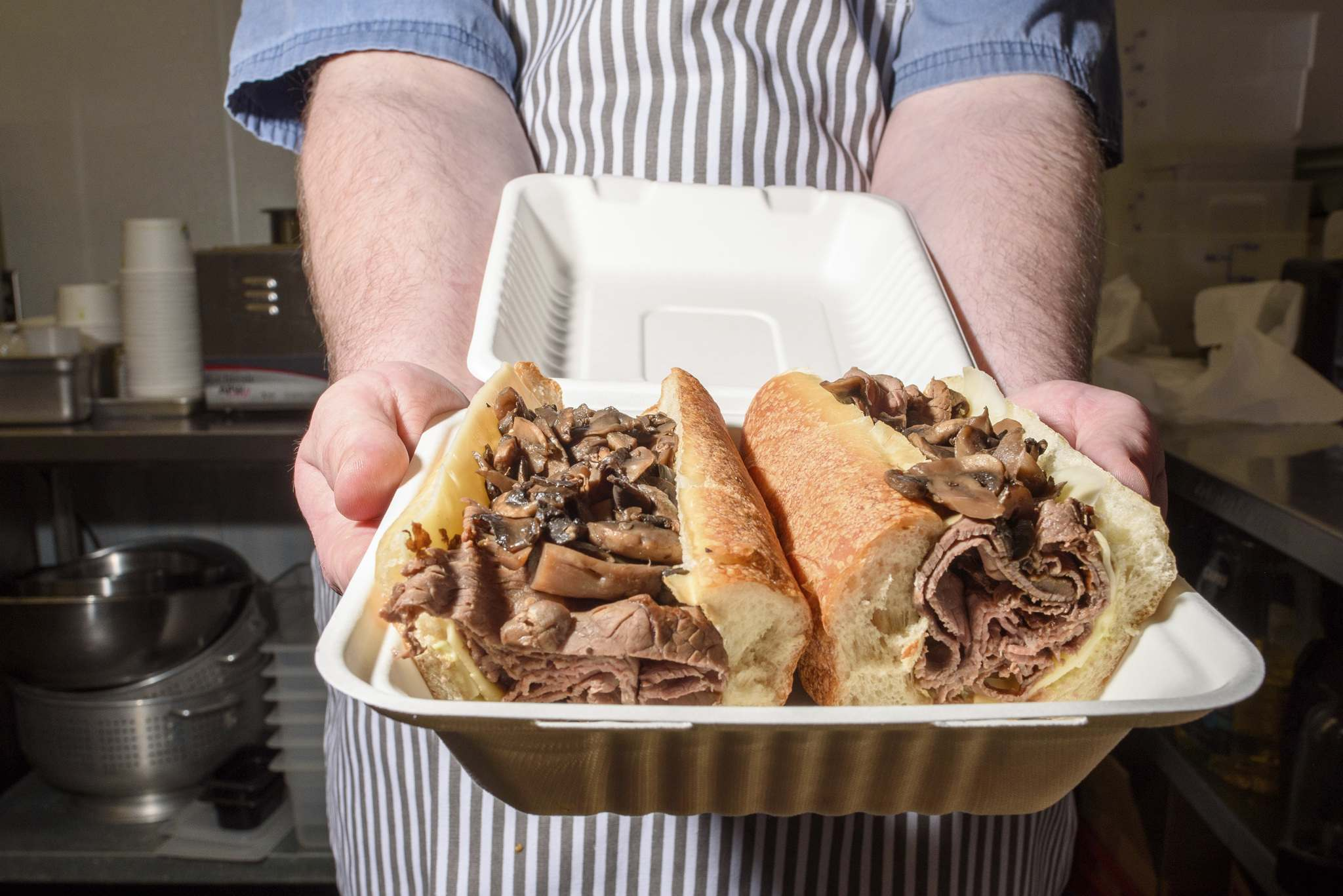 One of the popular beef dip sandwiches from Nick's on Broadway is served up by owner-chef Nick Graumann, who wanted to have a cafeteria-style restaurant where sandwiches were the stars of the show. (Jesse Boily / Winnipeg Free Press)</p>