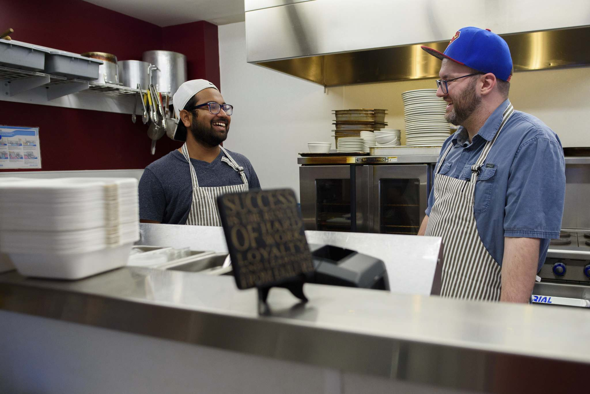 Nick Graumann (right), owner of Nick's on Broadway, shares a laugh with Sarifal Ridoy in the kitchen. (Jesse Boily / Winnipeg Free Press)</p>