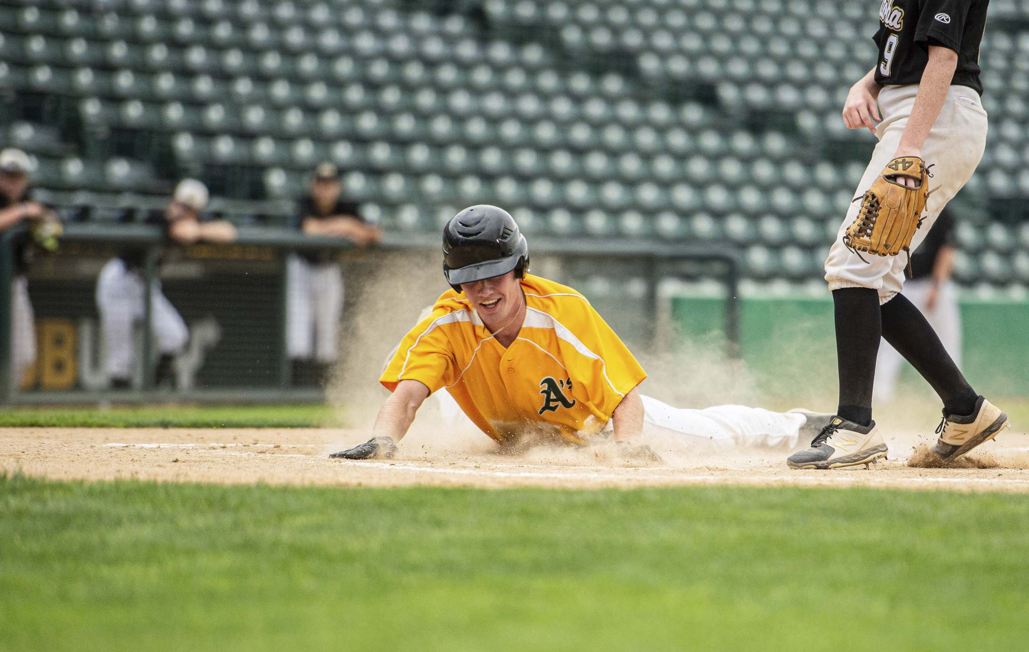 La Broquerie A's, Zac Tetrault slides to home plate in the third inning of their game against Team Manitoba's women's provincial team. (Mike Sudoma / Winnipeg Free Press)</p>