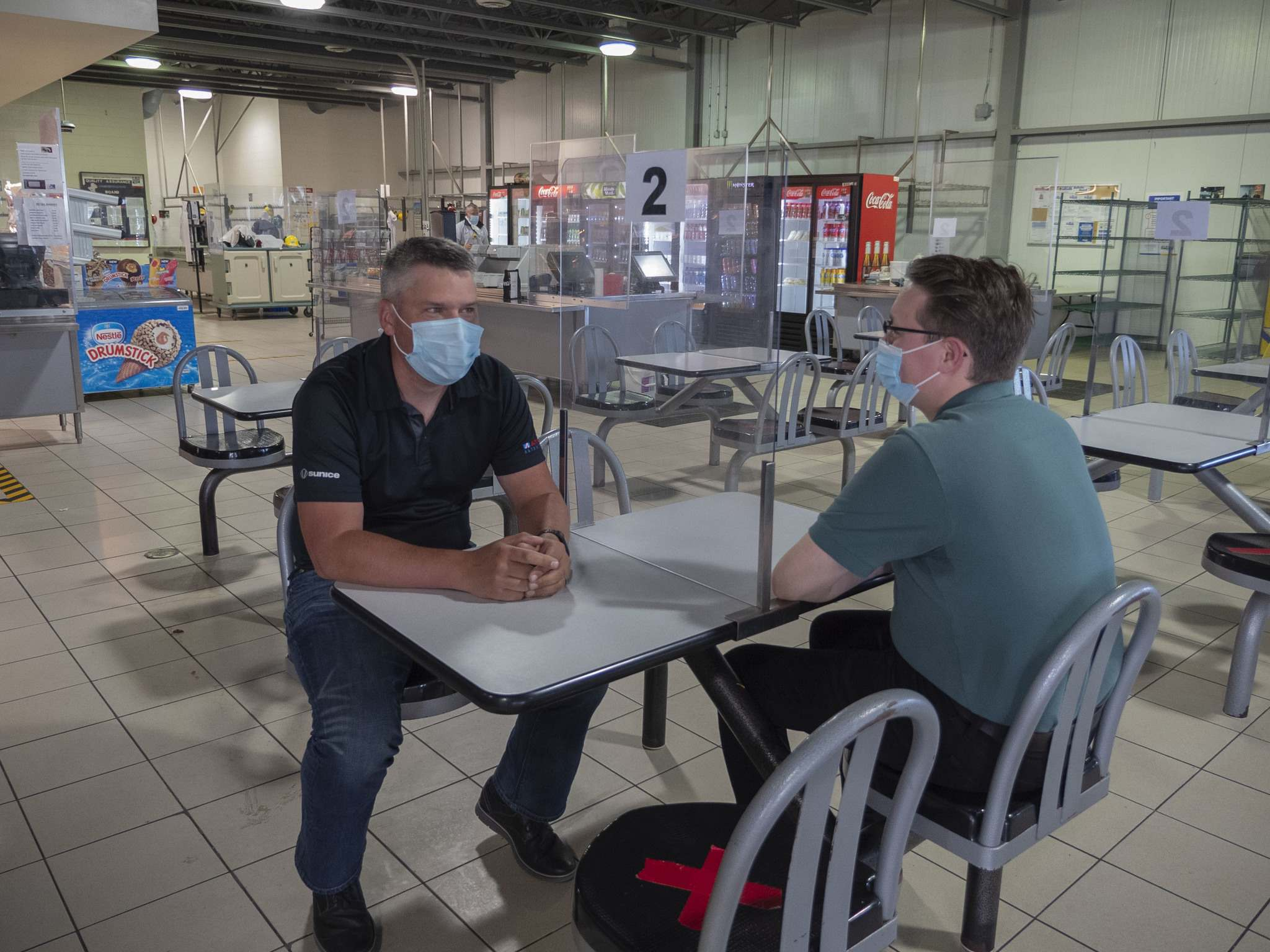 Plexiglas installed at the tables in the cafeteria at Maple Leaf Foods in Brandon, one of several steps it says it has taken to prevent spread of the coronavirus.