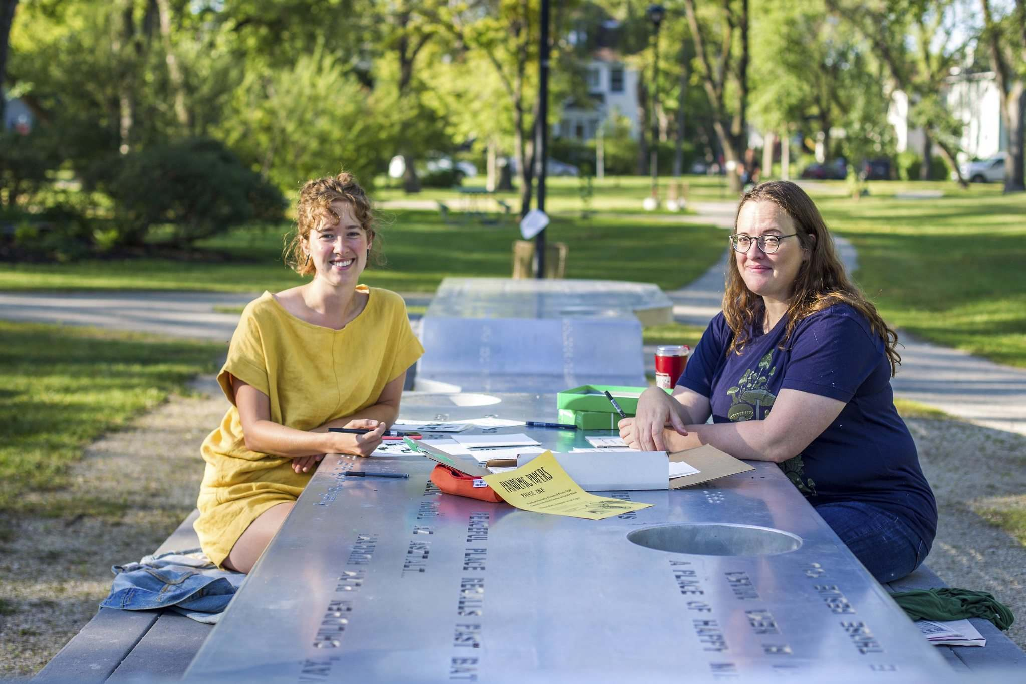 Natalie Baird (left) and Ariel Gordon work on their poetry and visual art project, Pandemic Papers, at Vimy Ridge Park.</p></p>