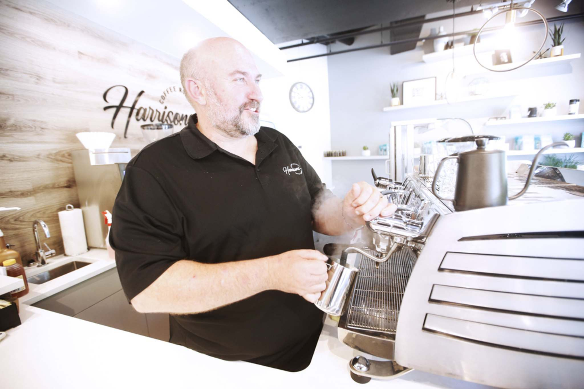 JOHN WOODS / WINNIPEG FREE PRESS</p><p>Al Dawson, owner of Harrisons Coffee Co., makes a latte at his new coffee shop and roaster on Waterfront Drive in Winnipeg.</p>