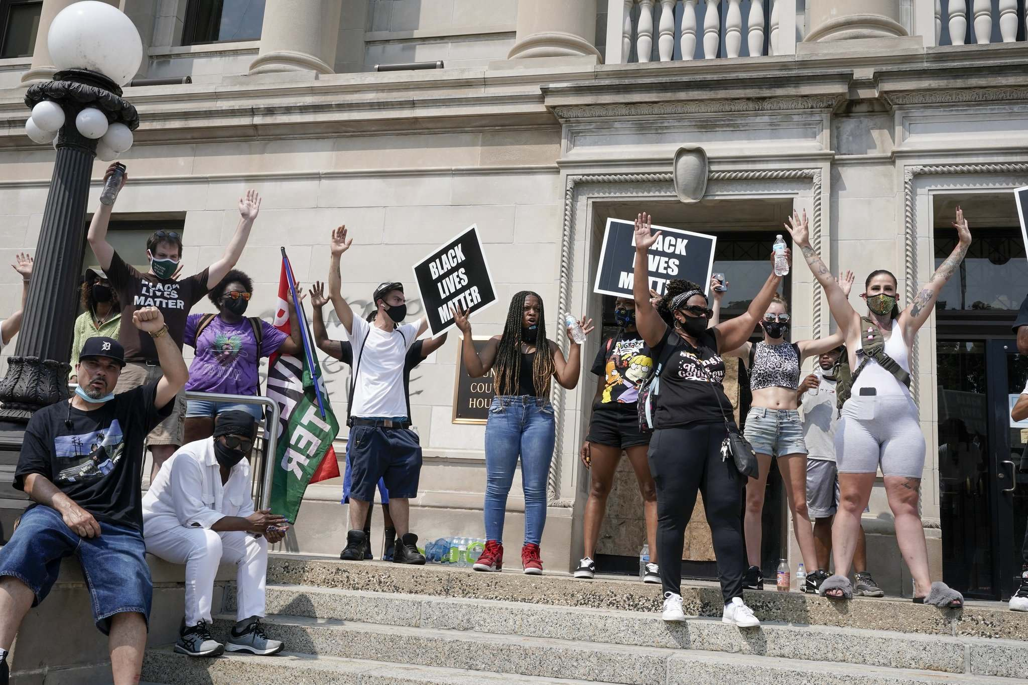 Morry Gash / The Associated Press</p><p>A small group of Black Lives Matter protesters hold a rally on the steps of the Kenosha County courthouse Monday, Aug. 24, 2020, in Kenosha, Wis. Kenosha police shot a man Sunday evening, setting off unrest in the city after a video appeared to show the officer firing several shots at close range into the man's back.</p>