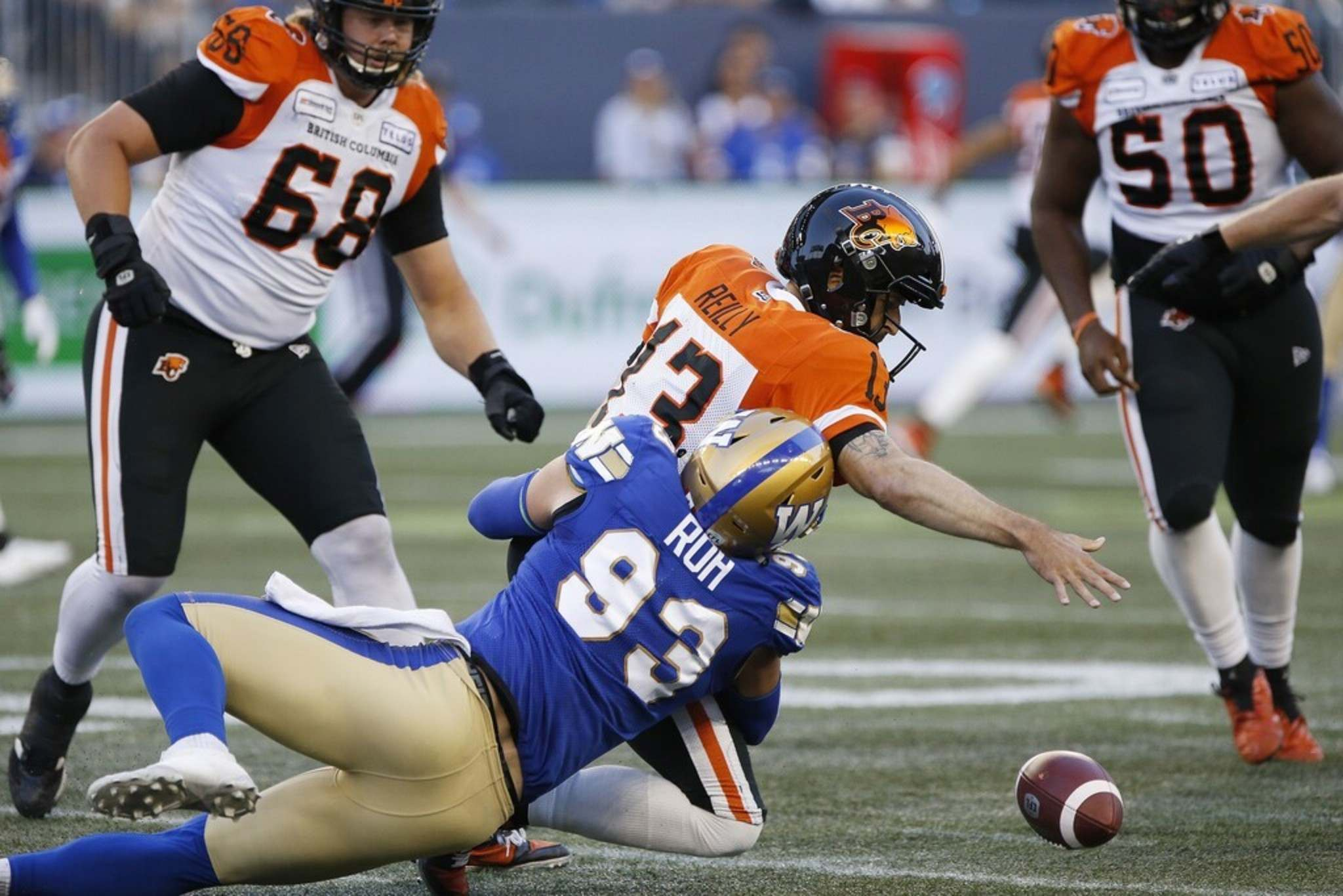 THE CANADIAN PRESS/John Woods</p><p>Winnipeg Blue Bombers' Craig Roh sacks BC Lions quarterback Mike Reilly and forces a fumble last August.</p>
