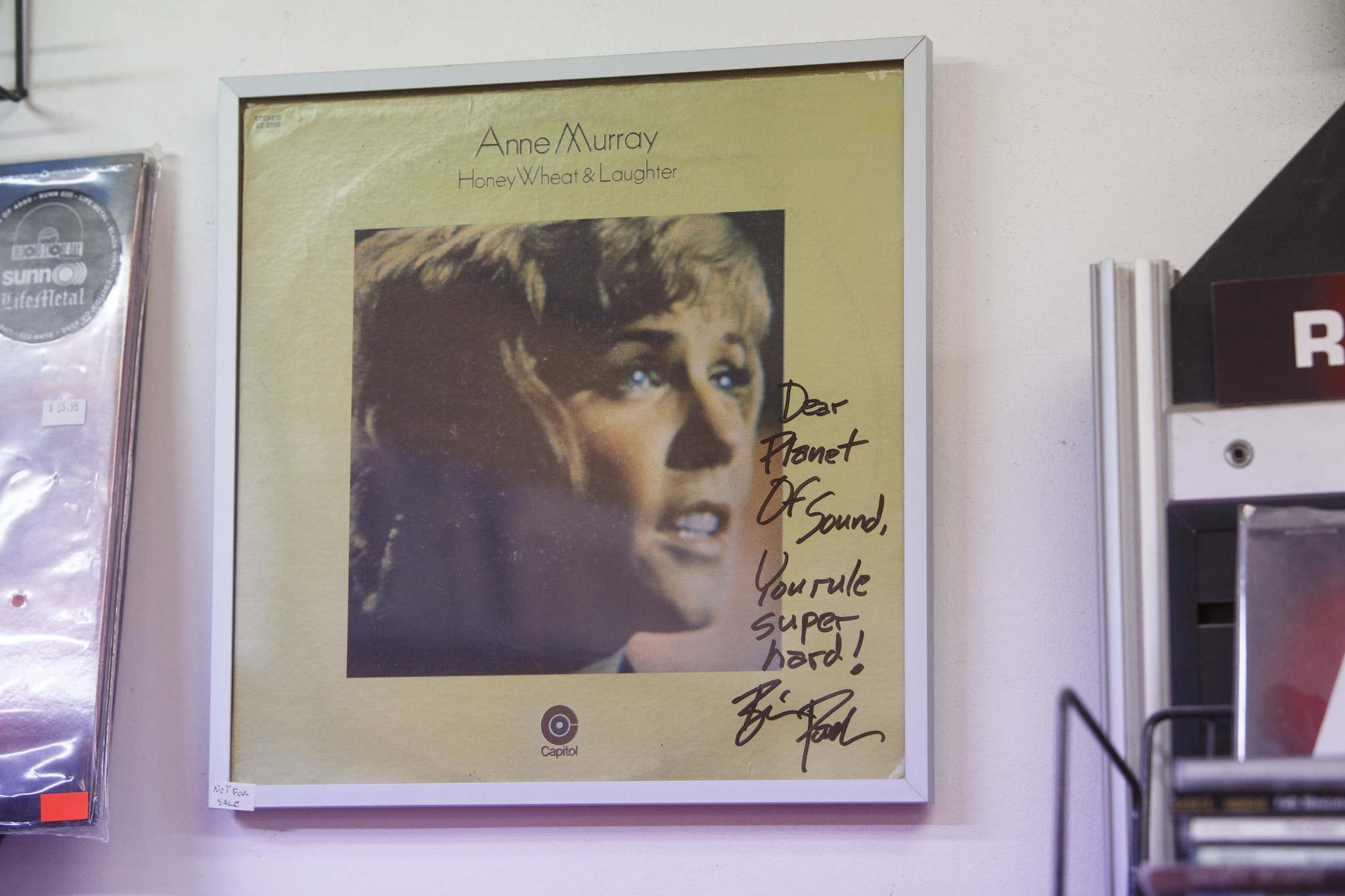 Wright asked actor/comedian Brian Posehn to sign a copy of Anne Murray's Honey, Wheat & Laughter that now hangs on the wall by the cash register.</p>