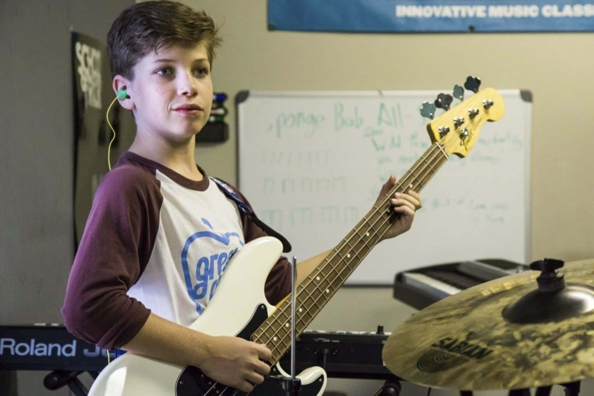 School of Rock students practice Pink Floyd's The Wall in preparation for their recital at The West End Cultural Centre. Jari Pedersen, 12, plays bass during a rehearsal session.