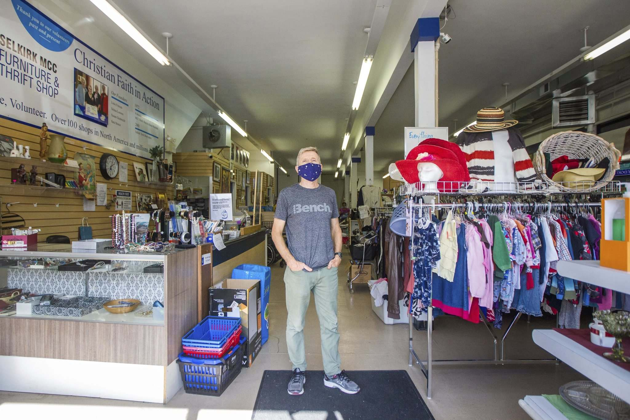 MCC Thrift Store manager Karl Langelotz says sales have been much the same at the Selkirk Avenue shop despite a reduction in operating hours. (Mikaela MacKenzie / Winnipeg Free Press)