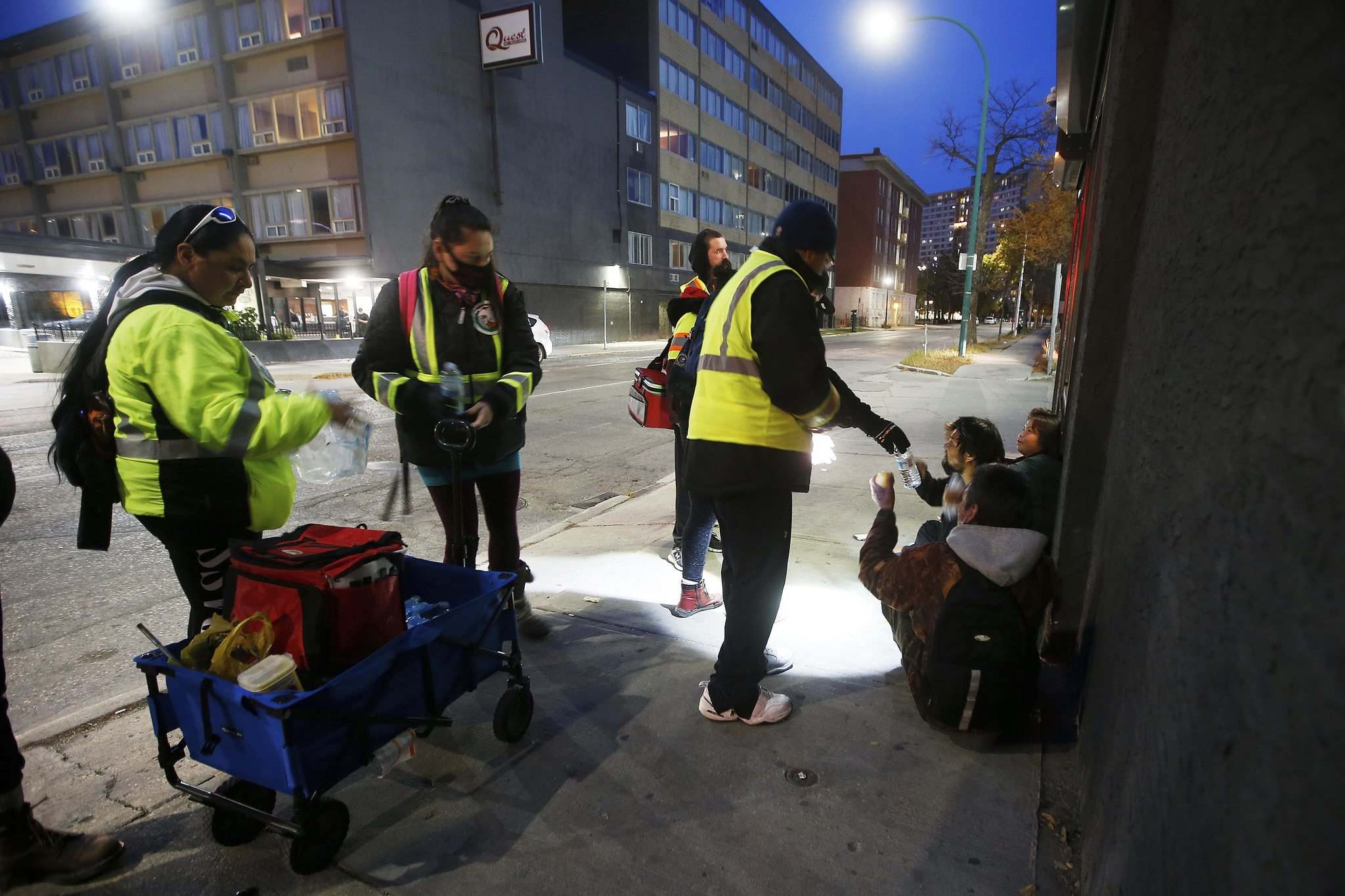 Thunderbirz volunteers hand out food and check on people's well-being.