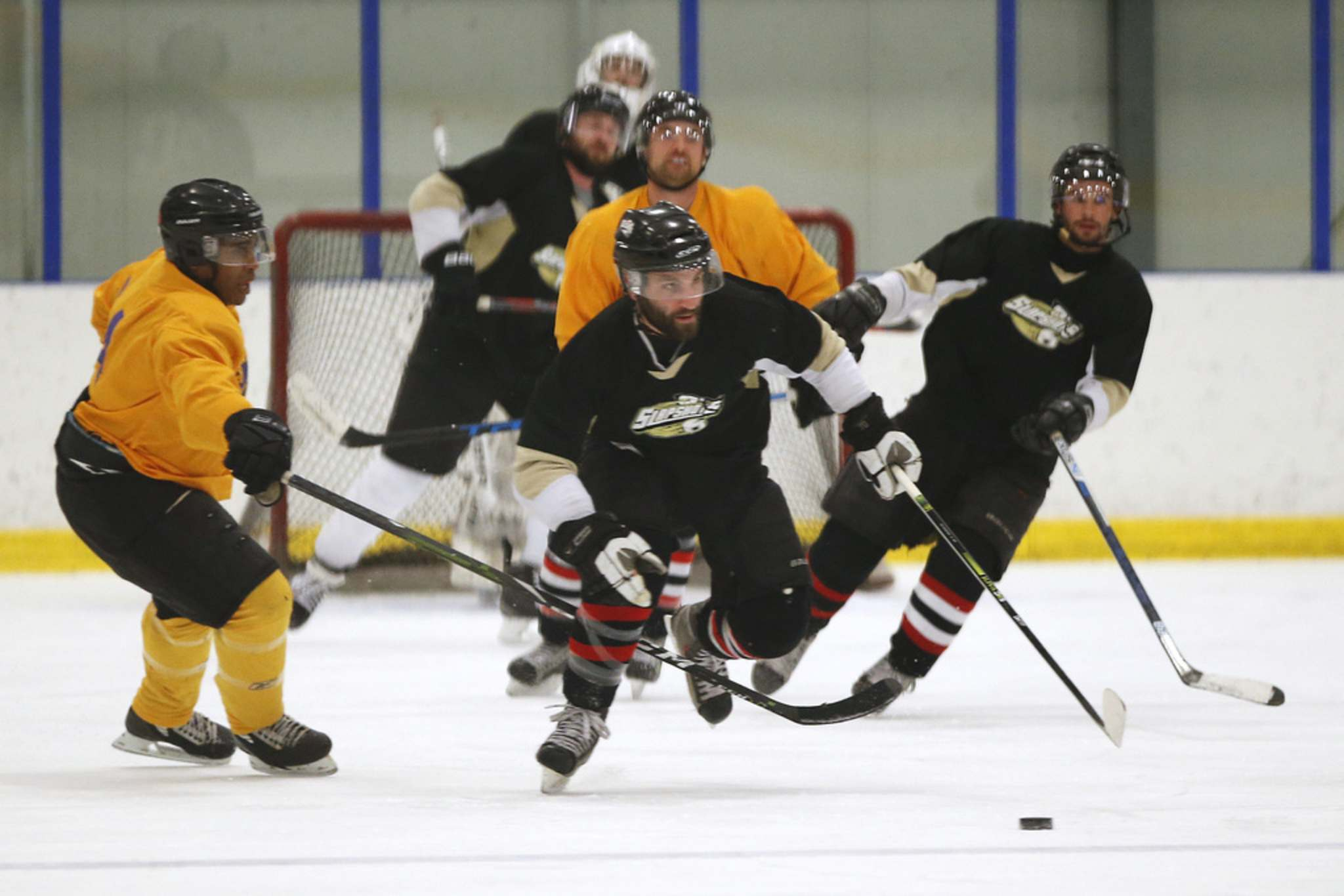 JOHN WOODS / WINNIPEG FREE PRESS</p><p>The Purple Reign (in yellow) play the Slapshots in division 3 of the Winnipeg Rec Hockey League at Seven Oaks Arena Monday.</p>