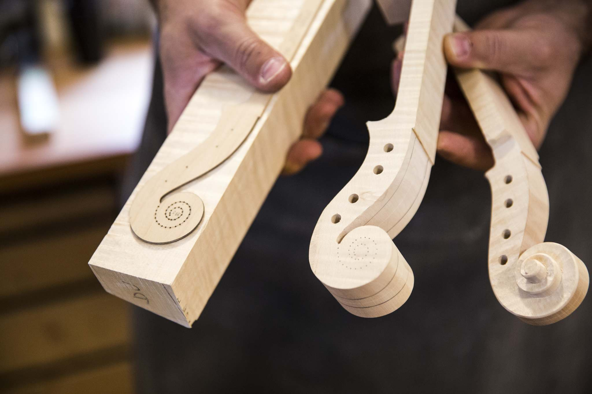 Violin scrolls in various stages of completion.