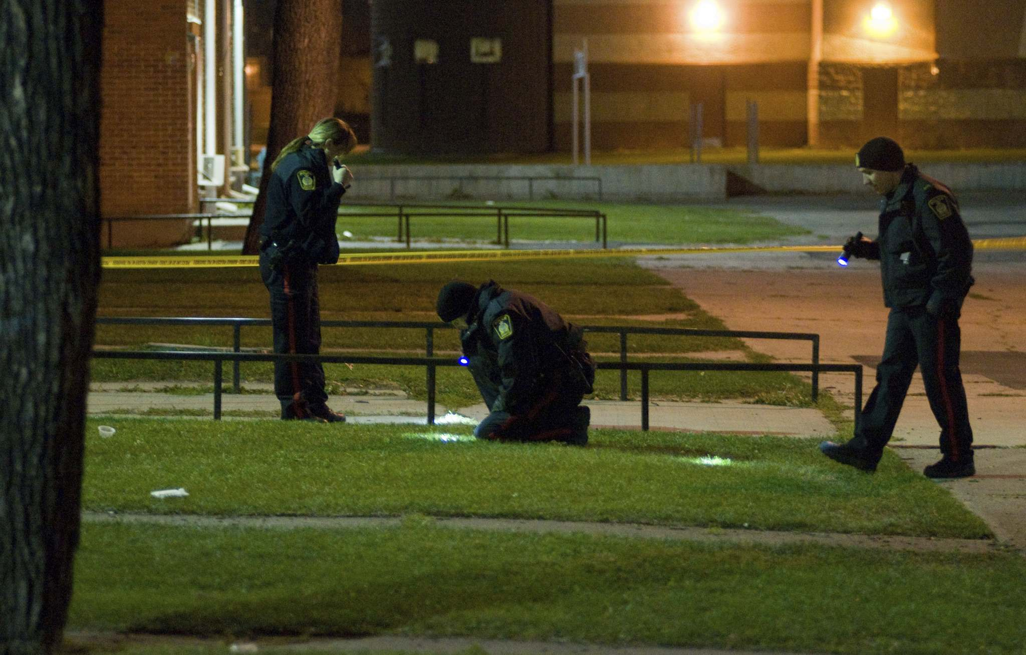 Police investigate outside the Lord Selkirk Park Housing Development where Samantha Stevenson was shot,