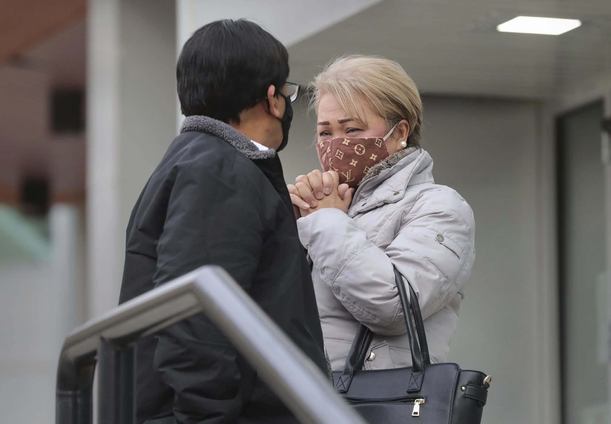 Imelda and Jaime Adao Sr. leave court after hearing Ronald Chubb plead guilty to second-degree murder and co-accused Geordie James plead guilty to manslaughter in the March 2019 killing of their son Jaime Adao.</p>