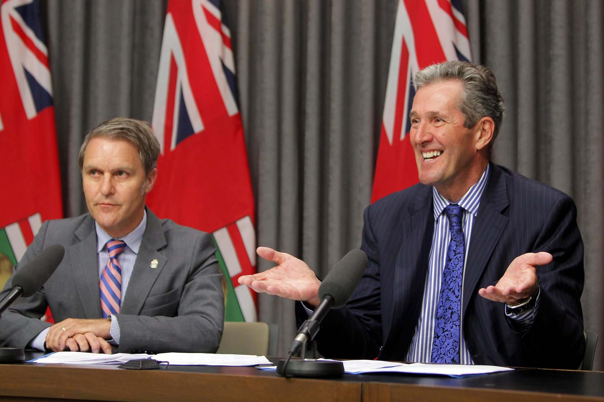 BORIS MINKEVICH / WINNIPEG FREE PRESS files Premier Brian Pallister (right) with Manitoba Minister of Finance Cameron Friesen.</p>
