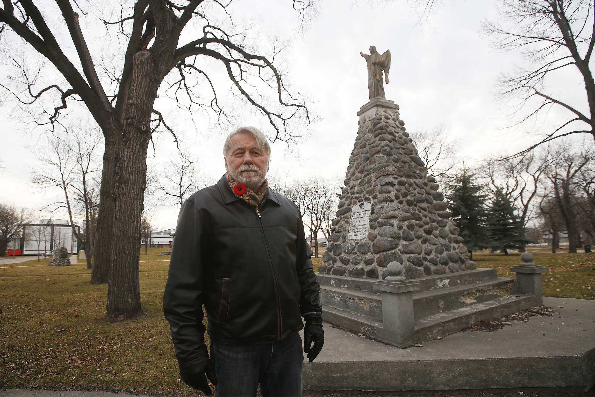 ohn Paskievich at a monument for Ukrainian soldiers killed in the Second World War; the filmmaker made A Canadian War Story over the course of three years. (John Woods / Winnipeg Free Press)