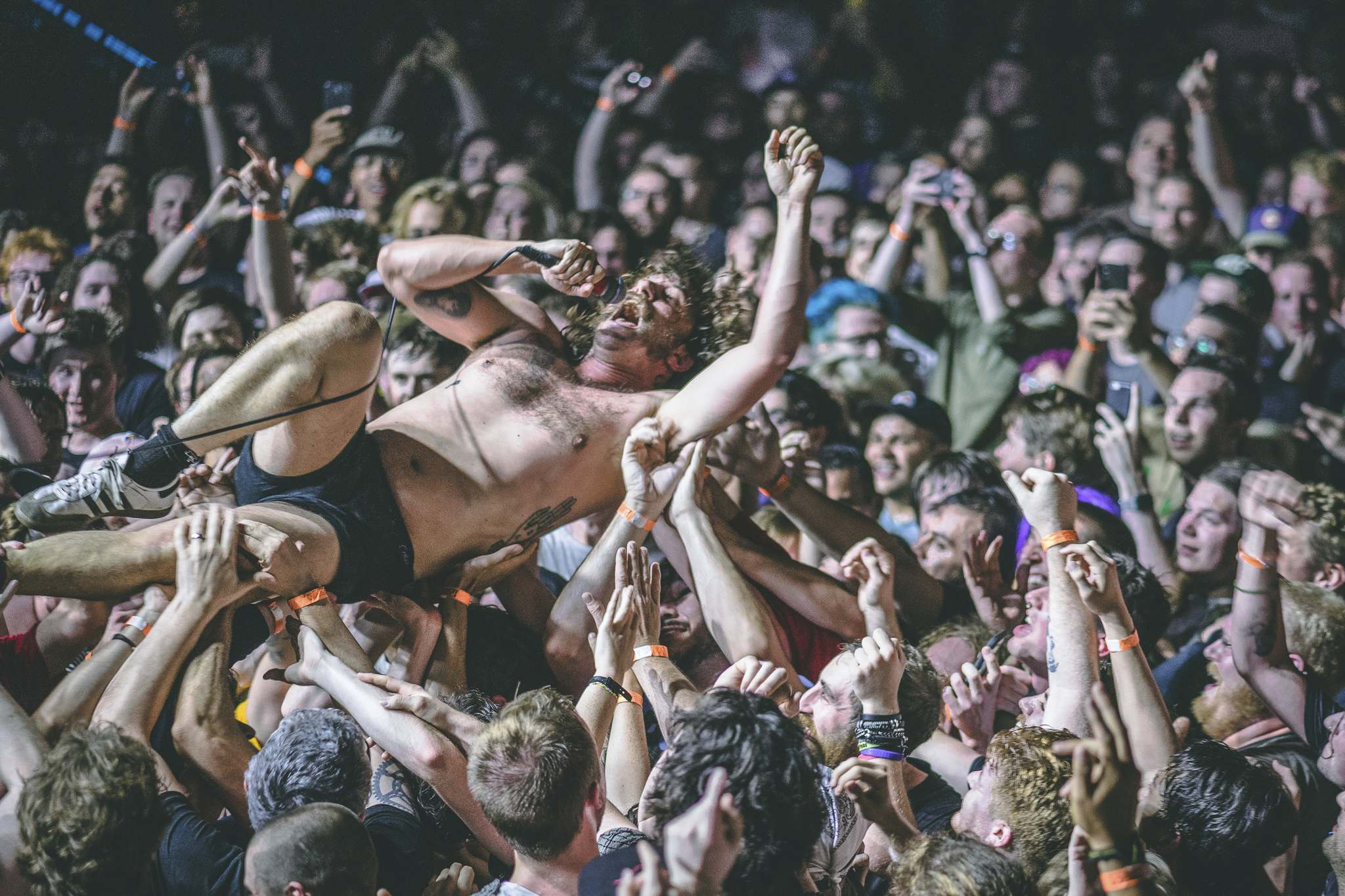 Mark Bowen, guitarist for the British punk group IDLES, surfs across the crowd during the band's performance at First Avenue in Minneapolis, MN. in 2019. (Mat Kleisinger photo)</p>