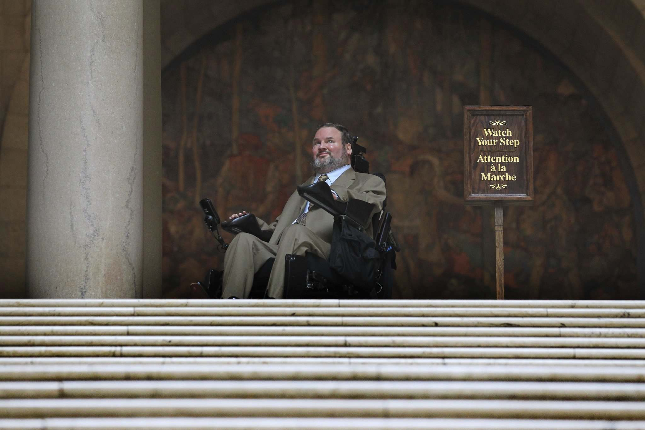 RUTH BONNEVILLE / WINNIPEG FREE PRESS</p><p>Assiniboia MLA Steven Fletcher, stops at the top of the stairs in the Legislative Building Tuesday morning after challenging plans for renovating the chamber to accommodate wheelchair access.</p>