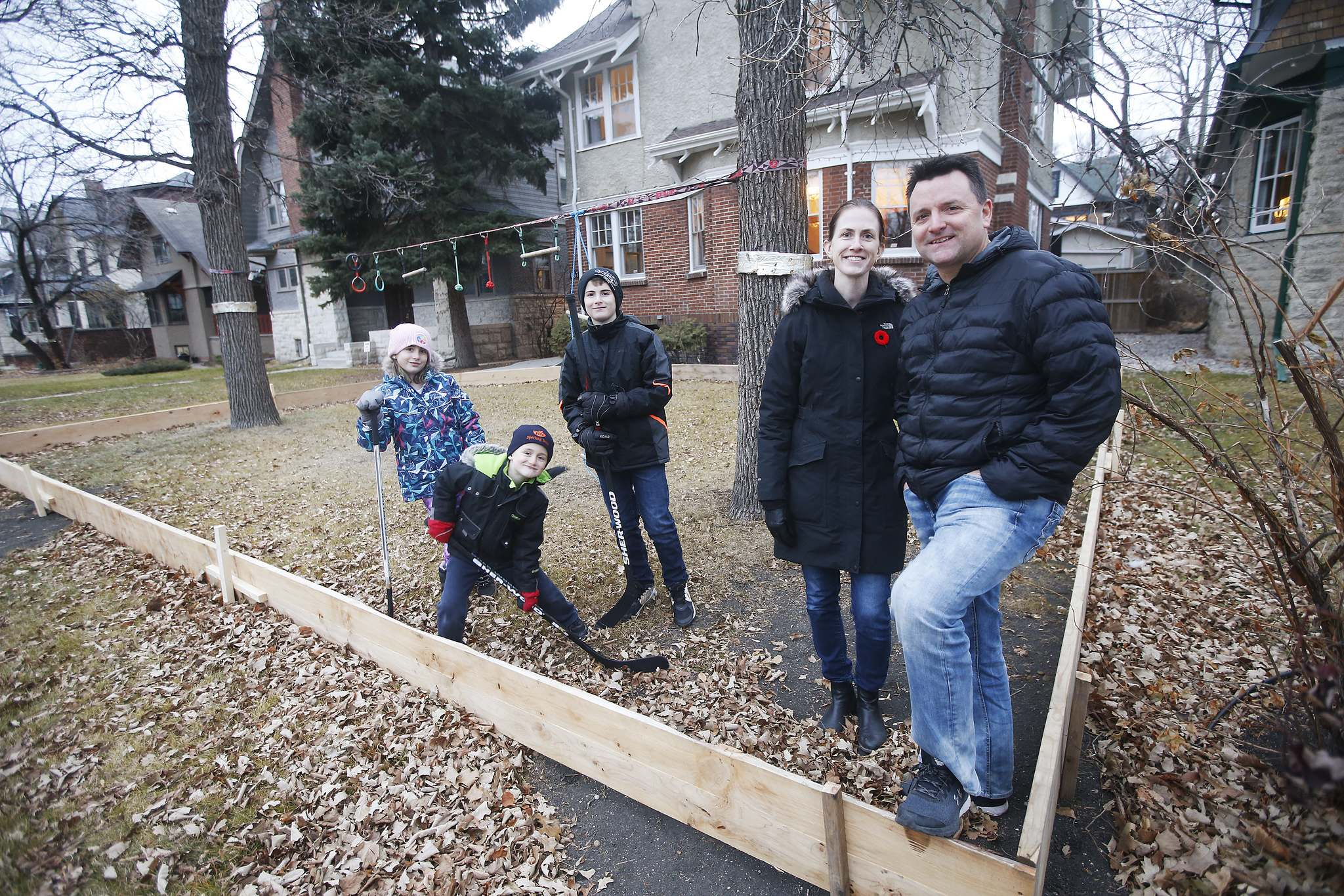 Shane and Kara McCartney are building a rink for their children (from left) Emerson, Blake and Aiden at their Crescentwood home.