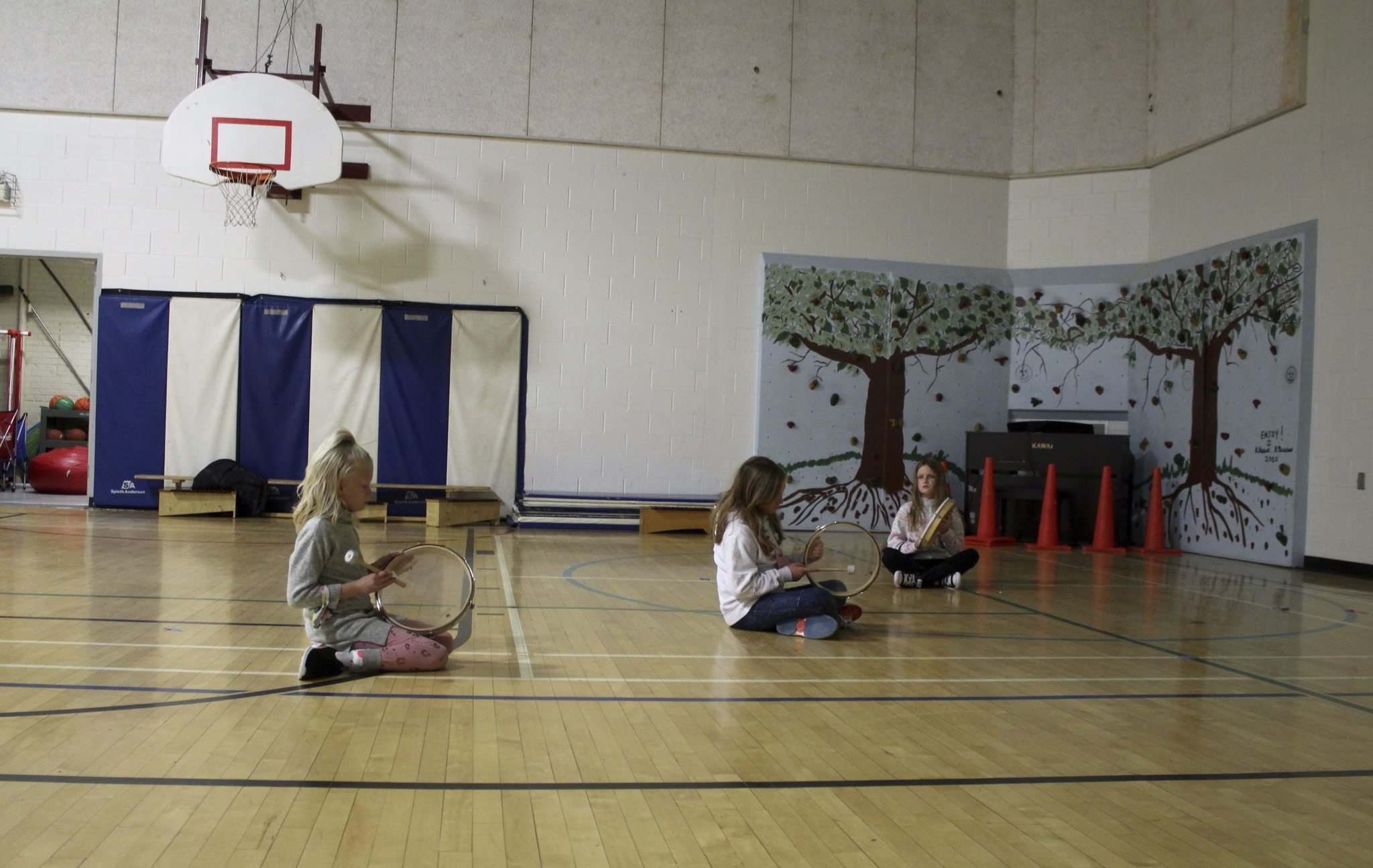 Socially-distanced music class takes place in the school gymnasium.