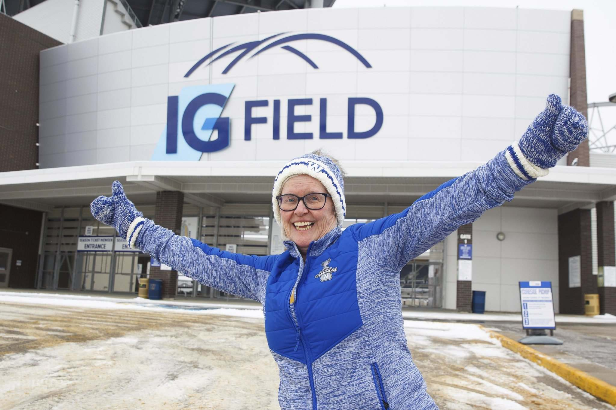"MIKE DEAL / WINNIPEG FREE PRESS</p> <p>Carol Barrott, ticket and fan services manager for the Winnipeg Blue Bombers, outside of IG Field Friday morning celebrating the one year anniversary of the team's Grey Cup win.</p> <p>""> </a><figcaption readability="