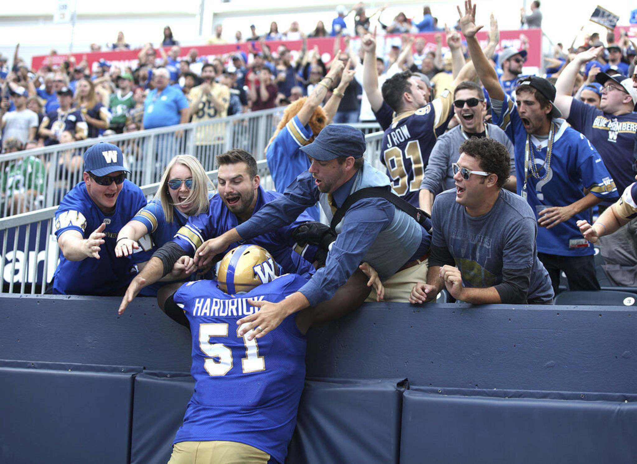 RUTH BONNEVILLE / WINNIPEG FREE PRESS FILES</p><p>Winnipeg Blue Bombers offensive lineman Jermarcus Hardrick gets some love from Bomber fans after the team scored a touchdown. It's safe to say the Bombers players are thinking about getting back to game action since the CFL released it's schedule for the 2021 season, Friday. </p>
